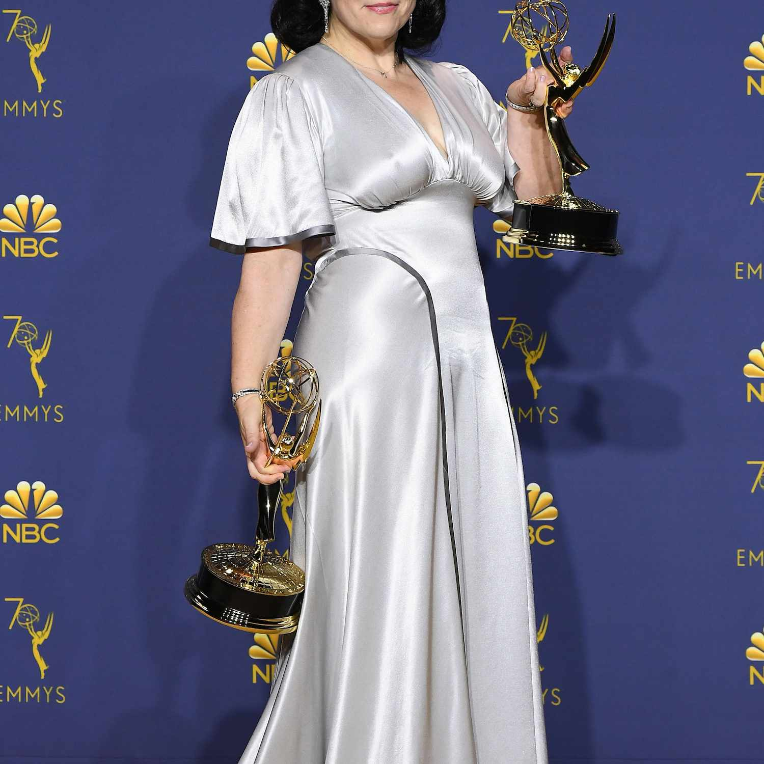 Alex Borstein holds up two Emmys at the 70th Annual Emmy Awards