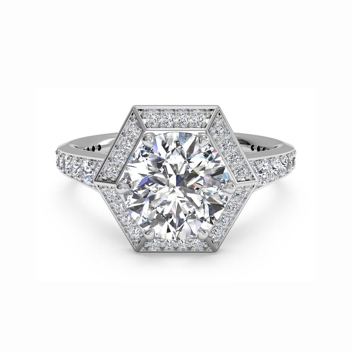 Round-cut diamond prong set with a vaulted diamond hexagonal halo and diamond band