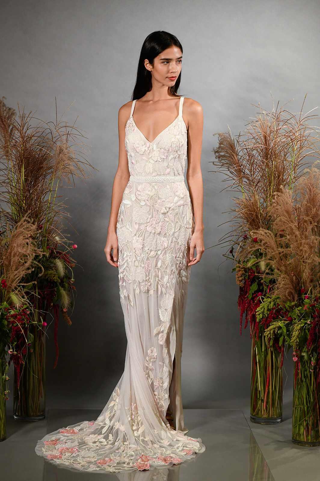 Model in plunging neckline sleeveless wedding dress