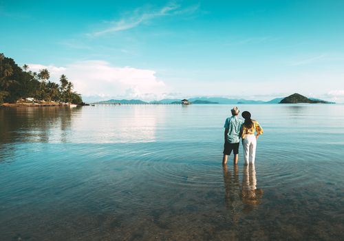 couple standing in water