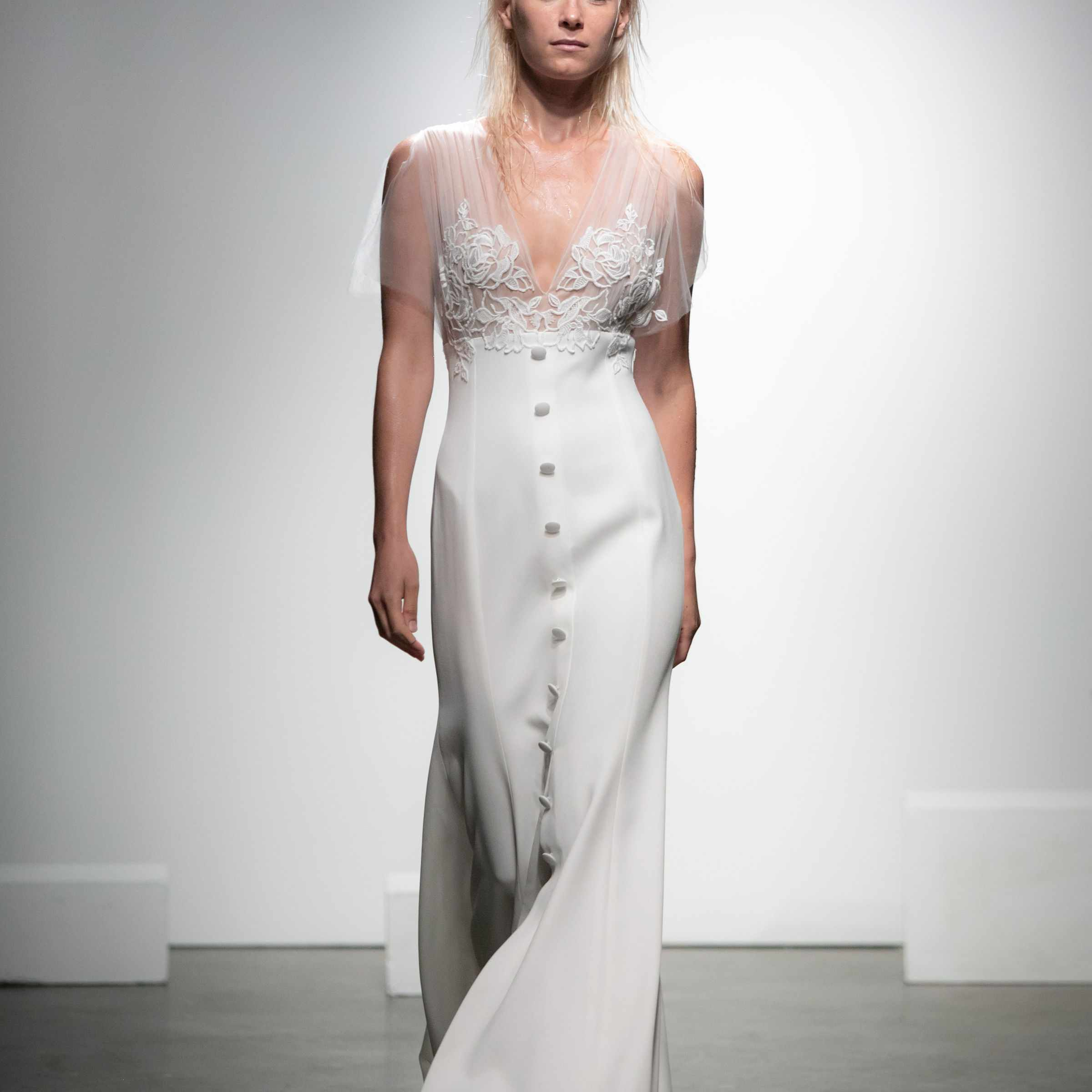 Model in button-down crepe dress with embroidered tulle