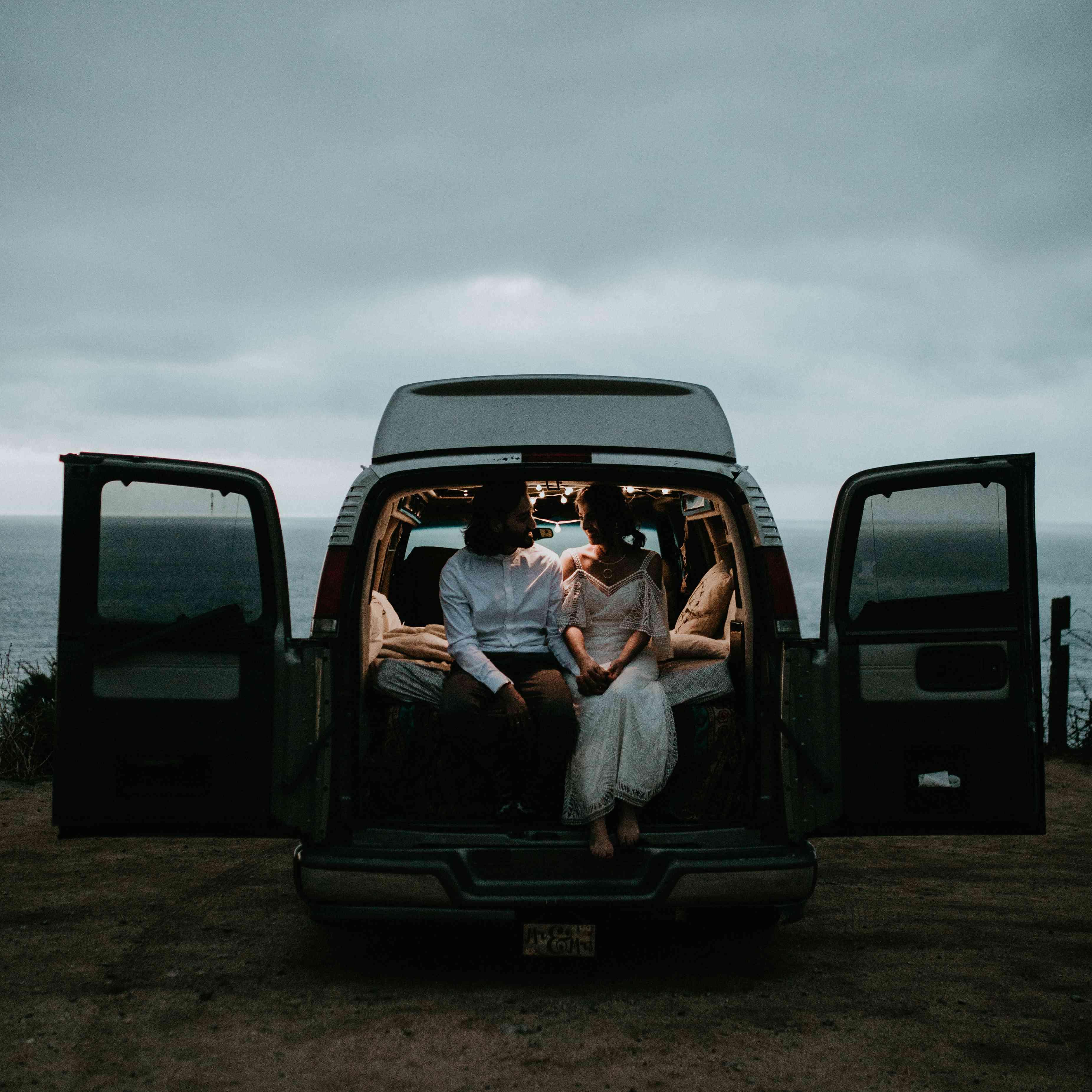 <p>bride and groom in getaway van</p>