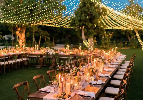 U-shaped, candle-lit reception layout with peaked canopy of string lights overhead