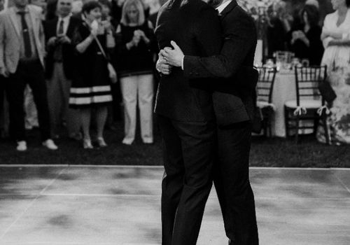Two grooms sharing first dance at their wedding