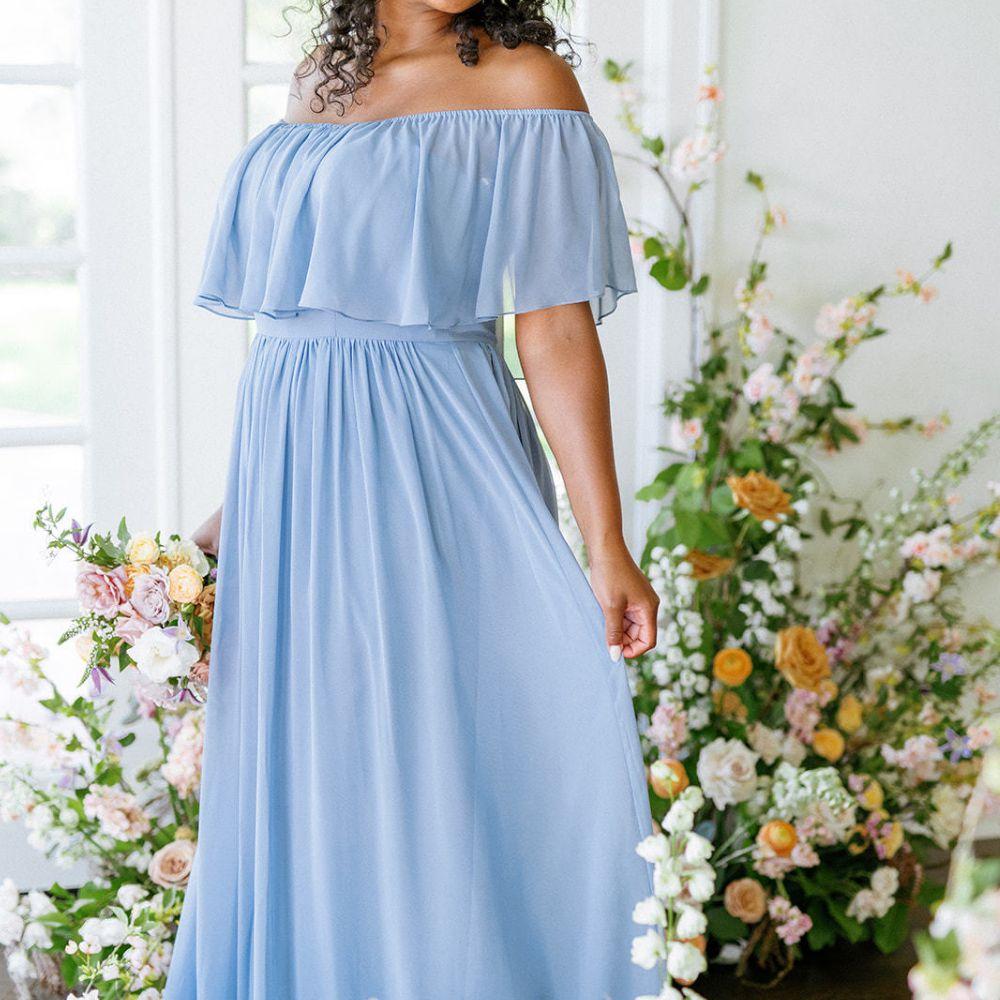Model in light blue off-the-shoulder flutter sleeve chiffon dress