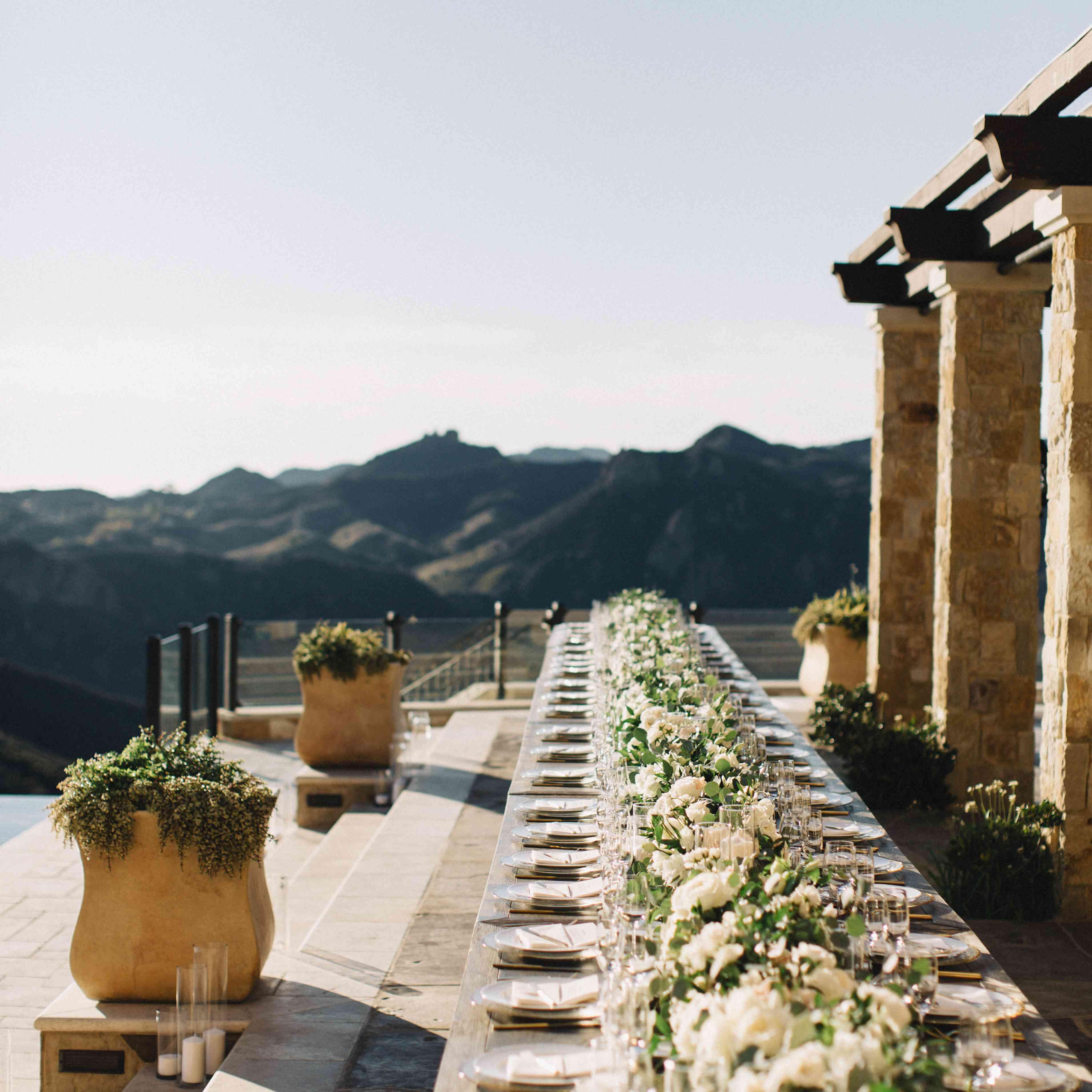 Alfresco wedding reception dinner set-up