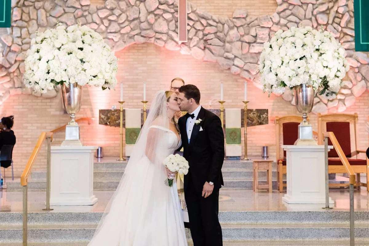 Wedding with white floral arrangements