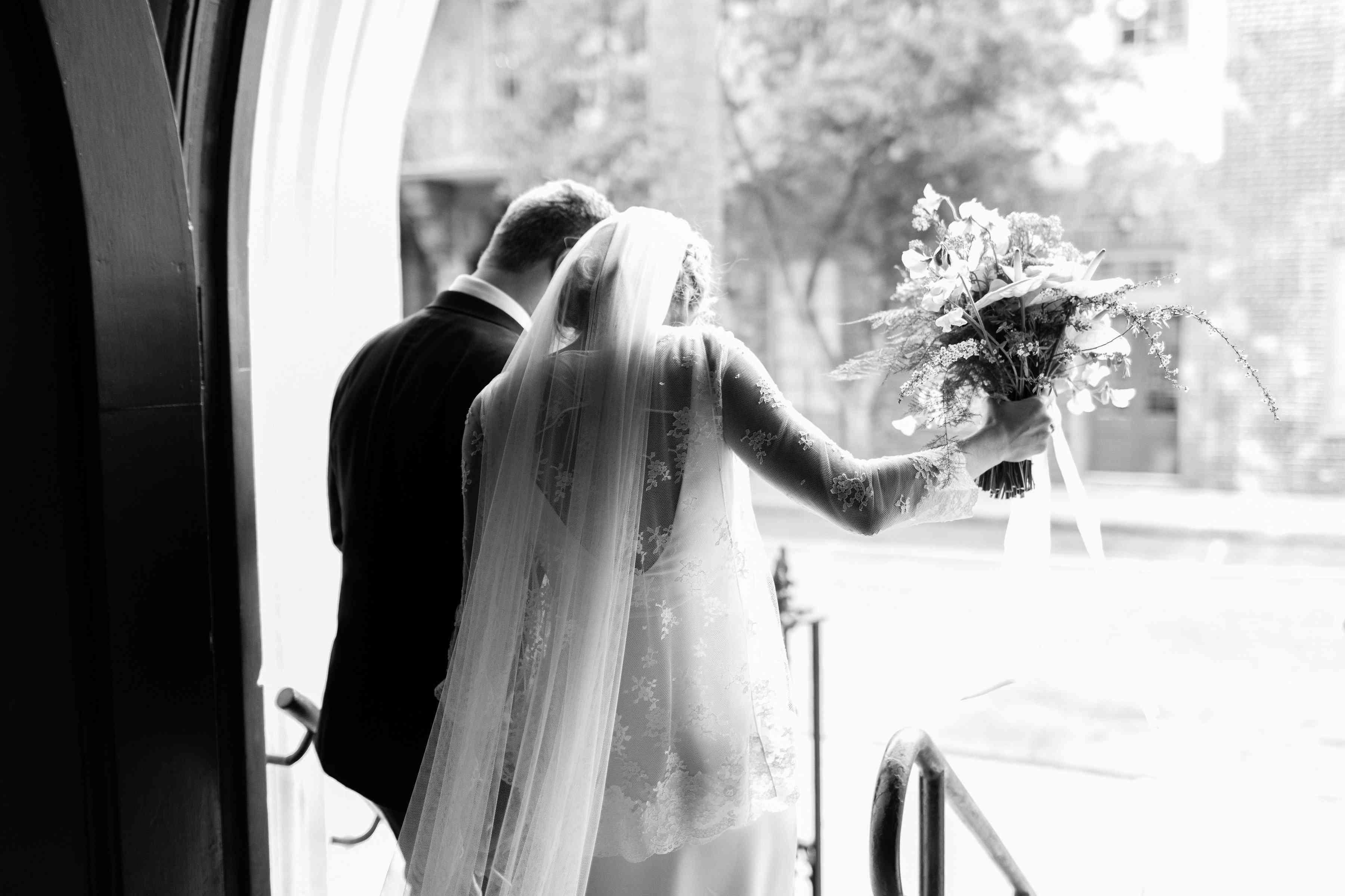 bride and groom exiting church wedding