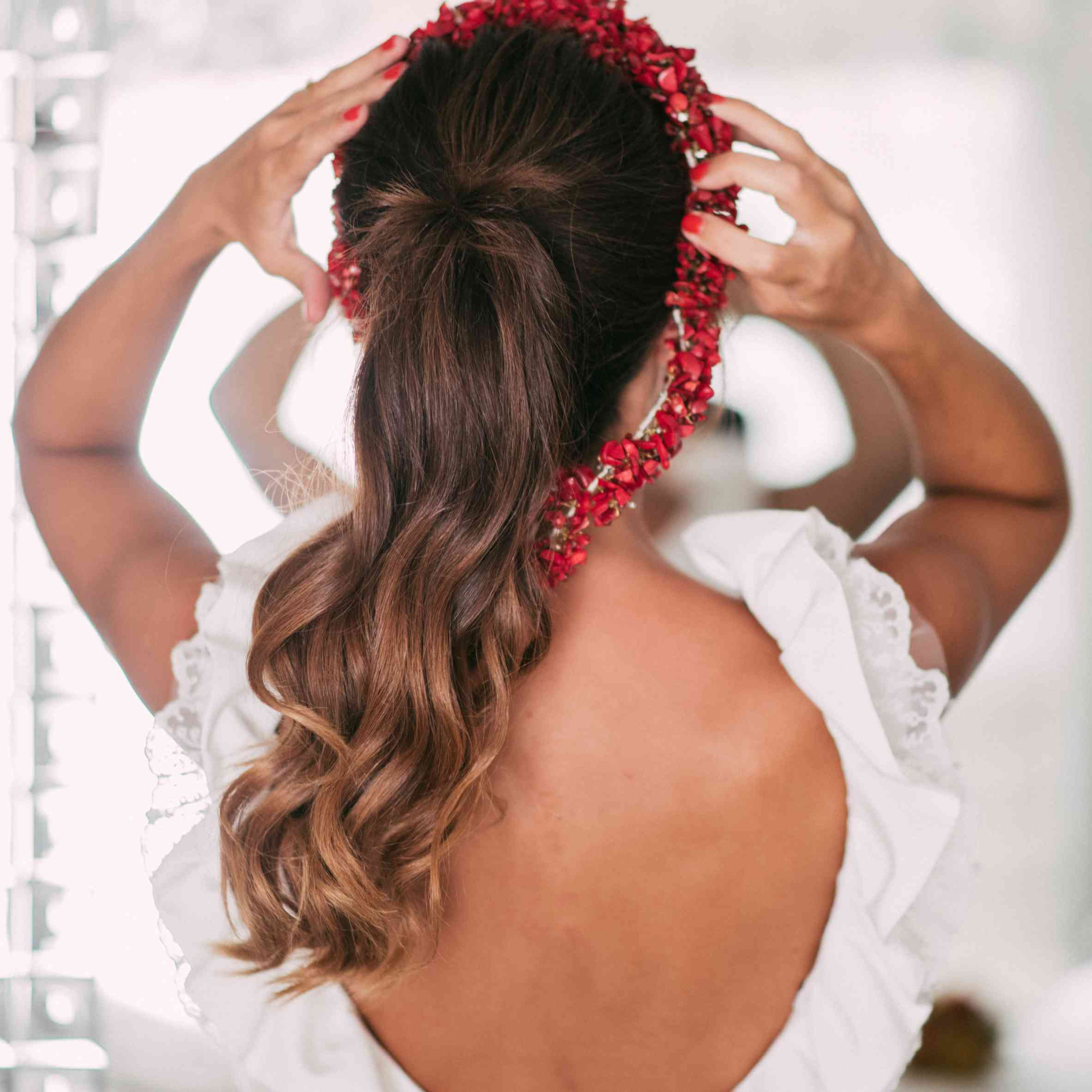Bride putting on floral crown
