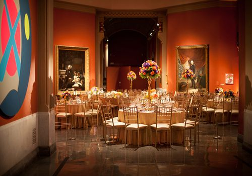 Round tables set for a wedding inside museum venue