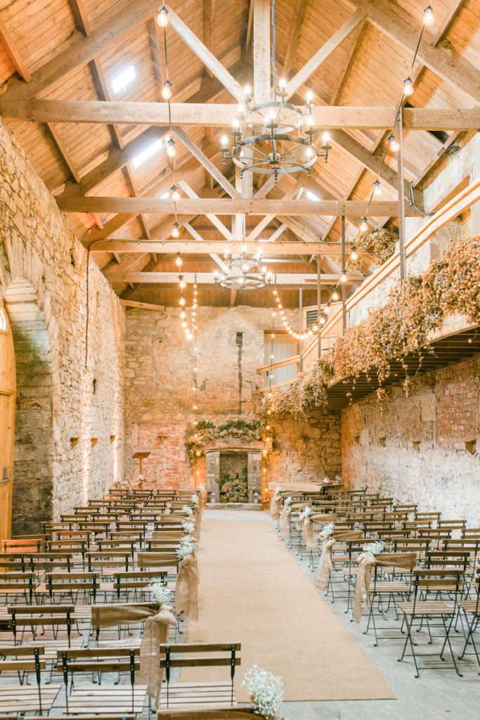Wedding ceremony in an old stone barn
