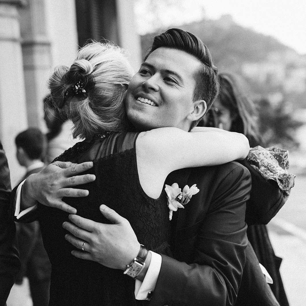 Zach hugs a guest