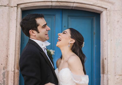 <p>bride and groom laughing</p>