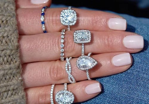 A hand with engagement rings