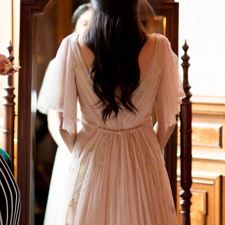 <p>portrait of bride from back view</p>