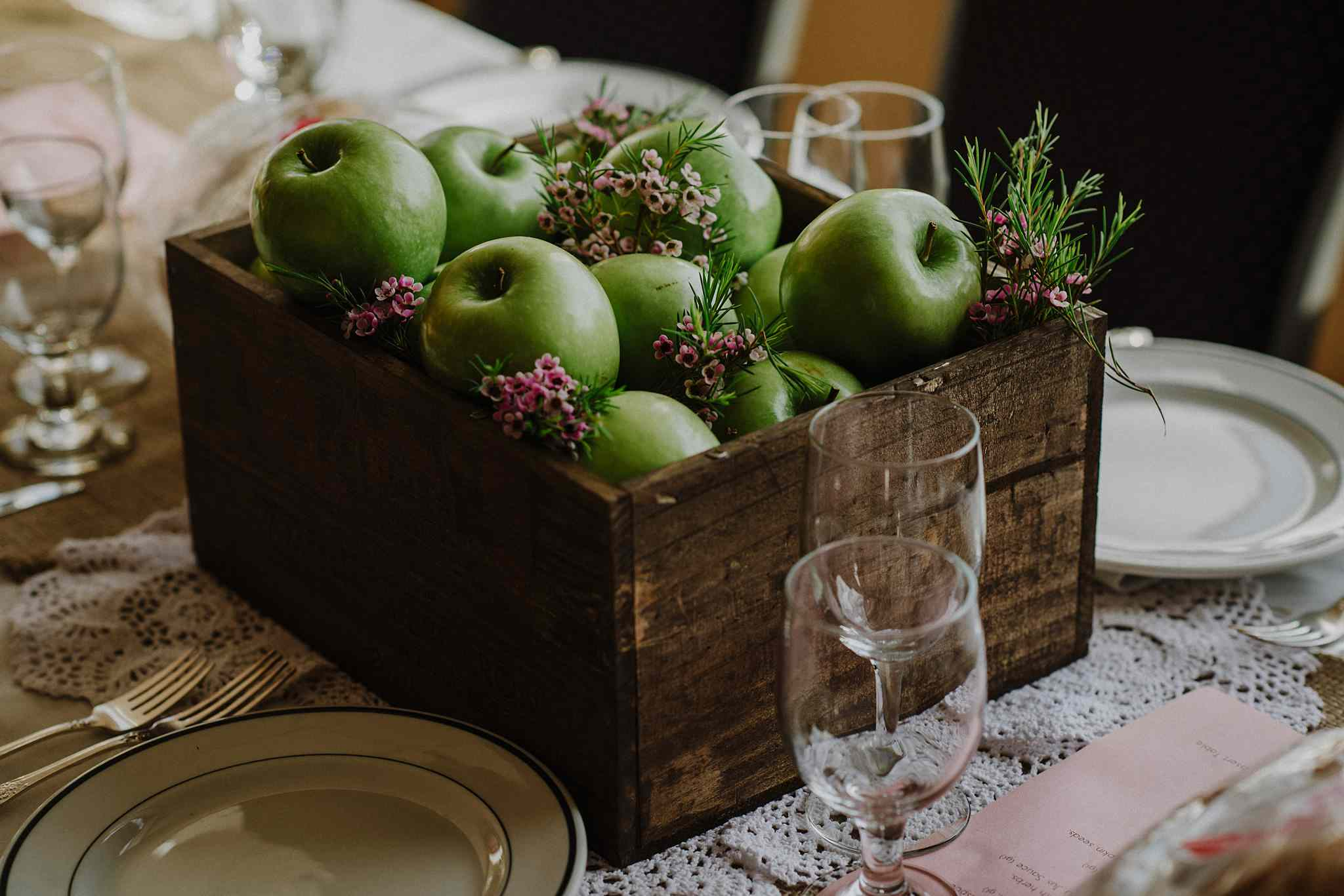 Green apples in a wooden box as a centerpiece