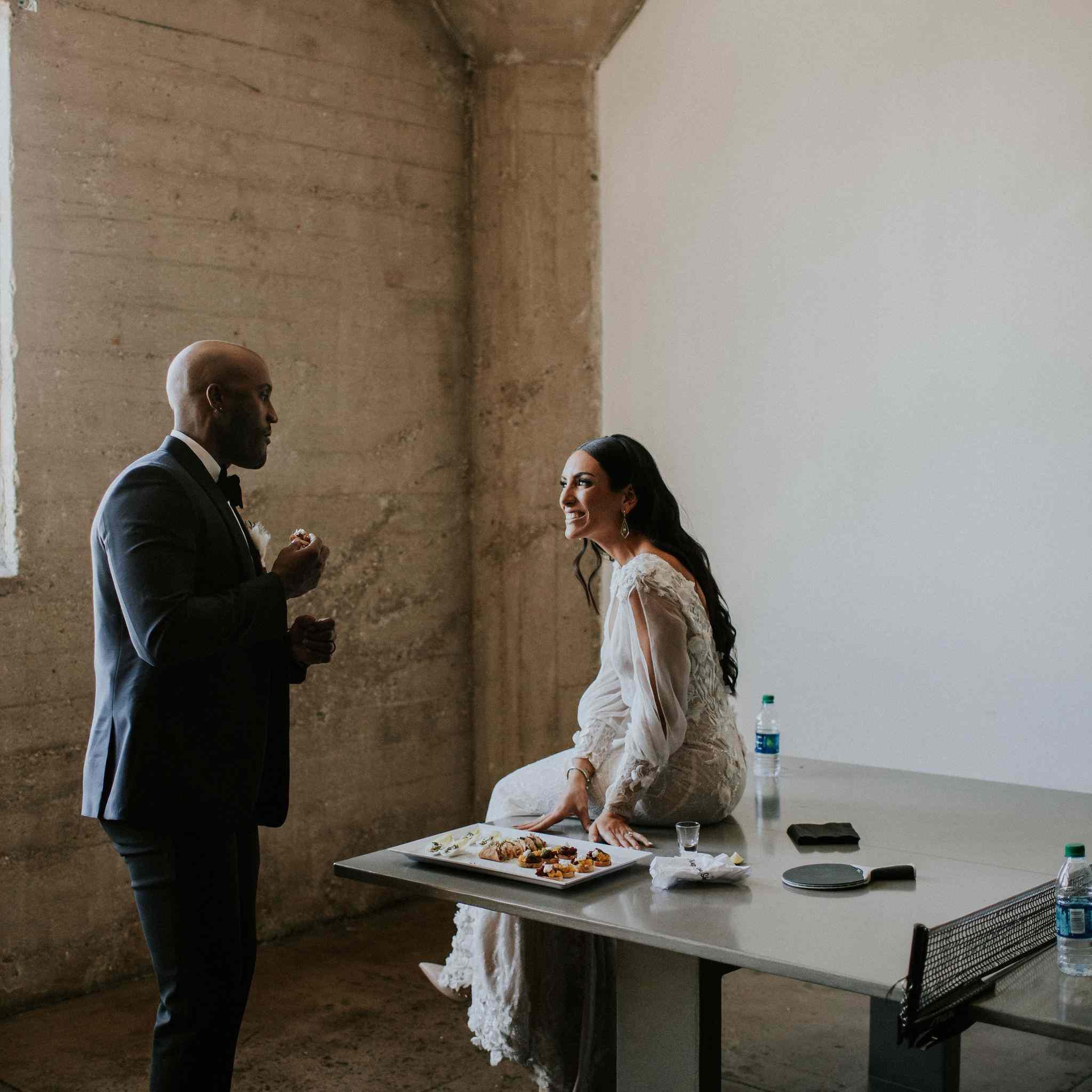 Bride and groom snacking between events