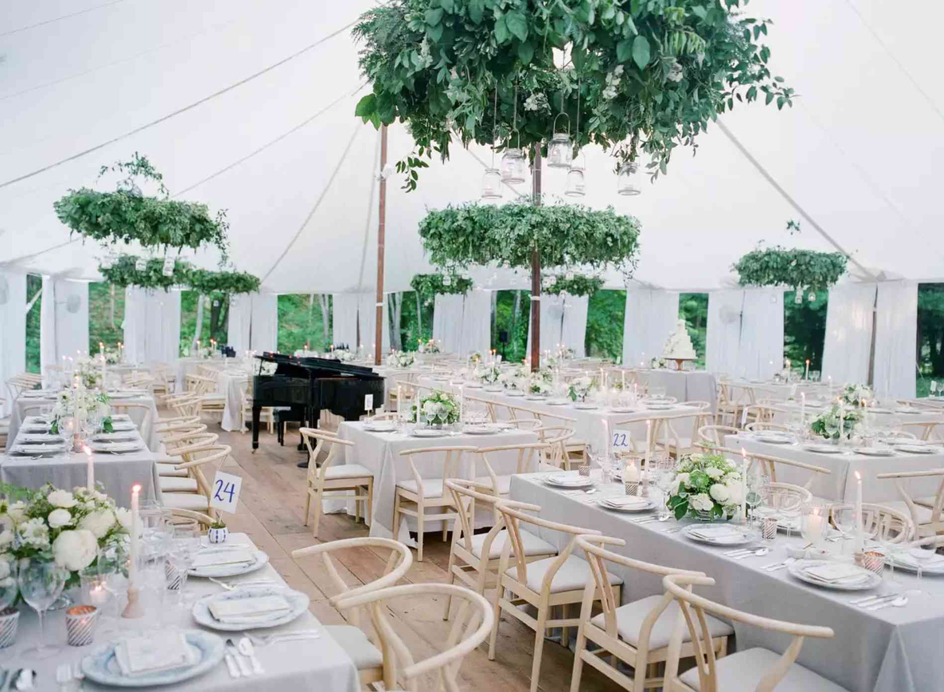 Tented reception with greenery and gray linens