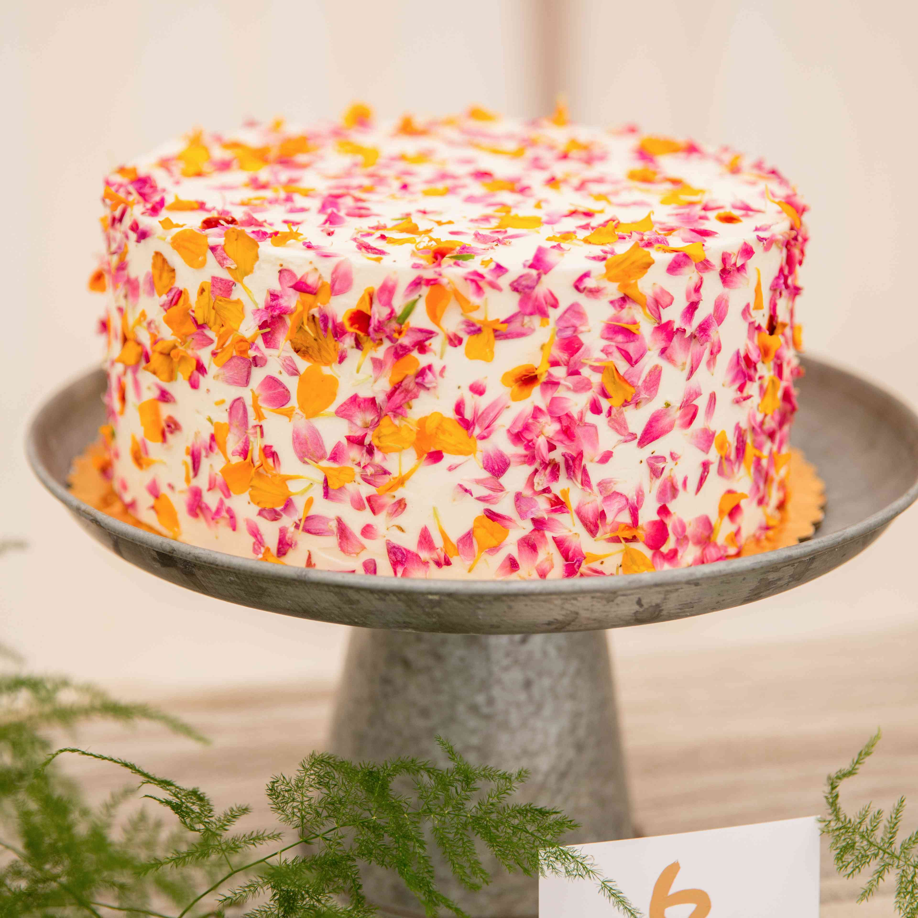 A wedding cake with pressed petals
