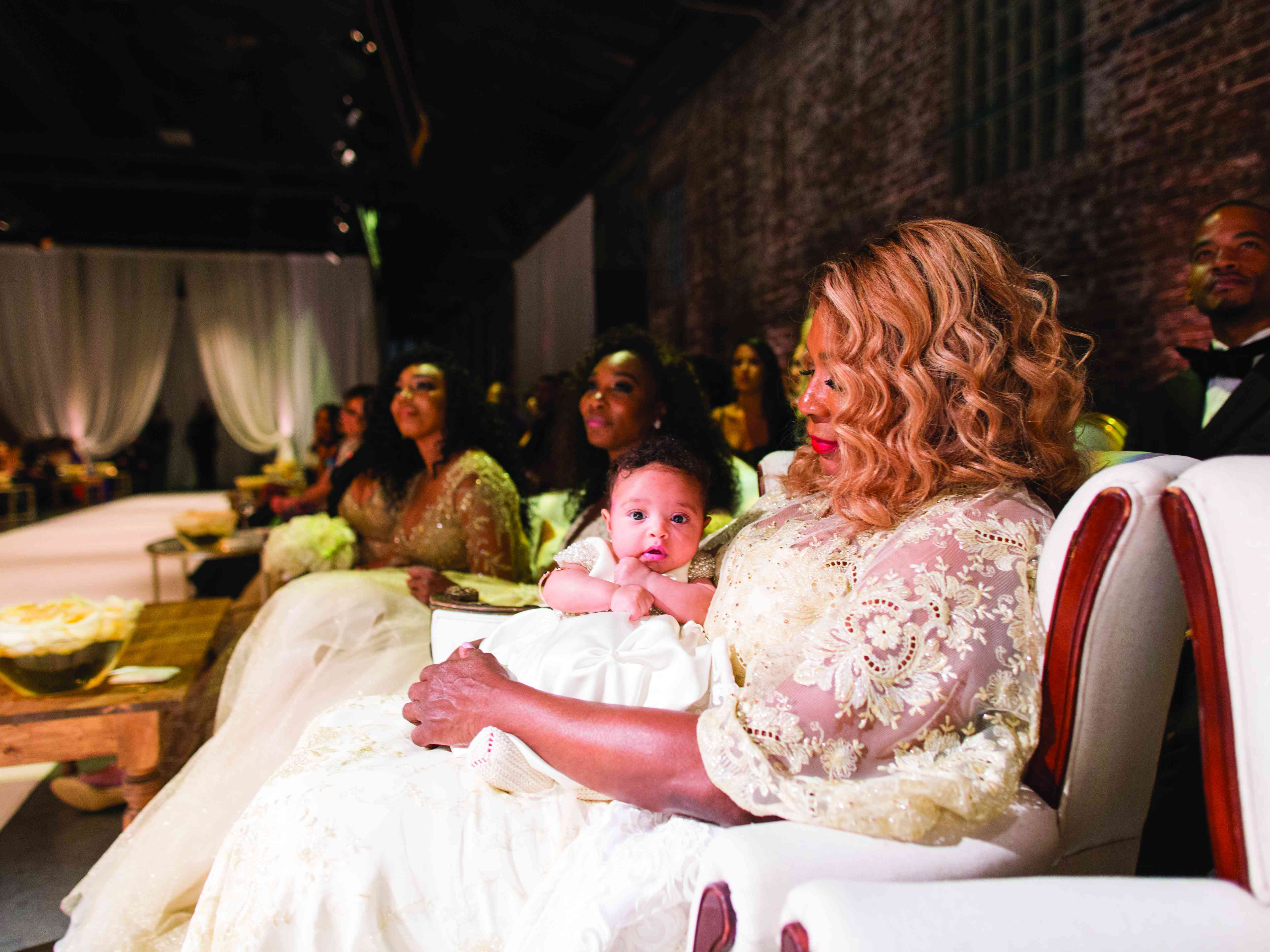 mother of the bride holding newborn