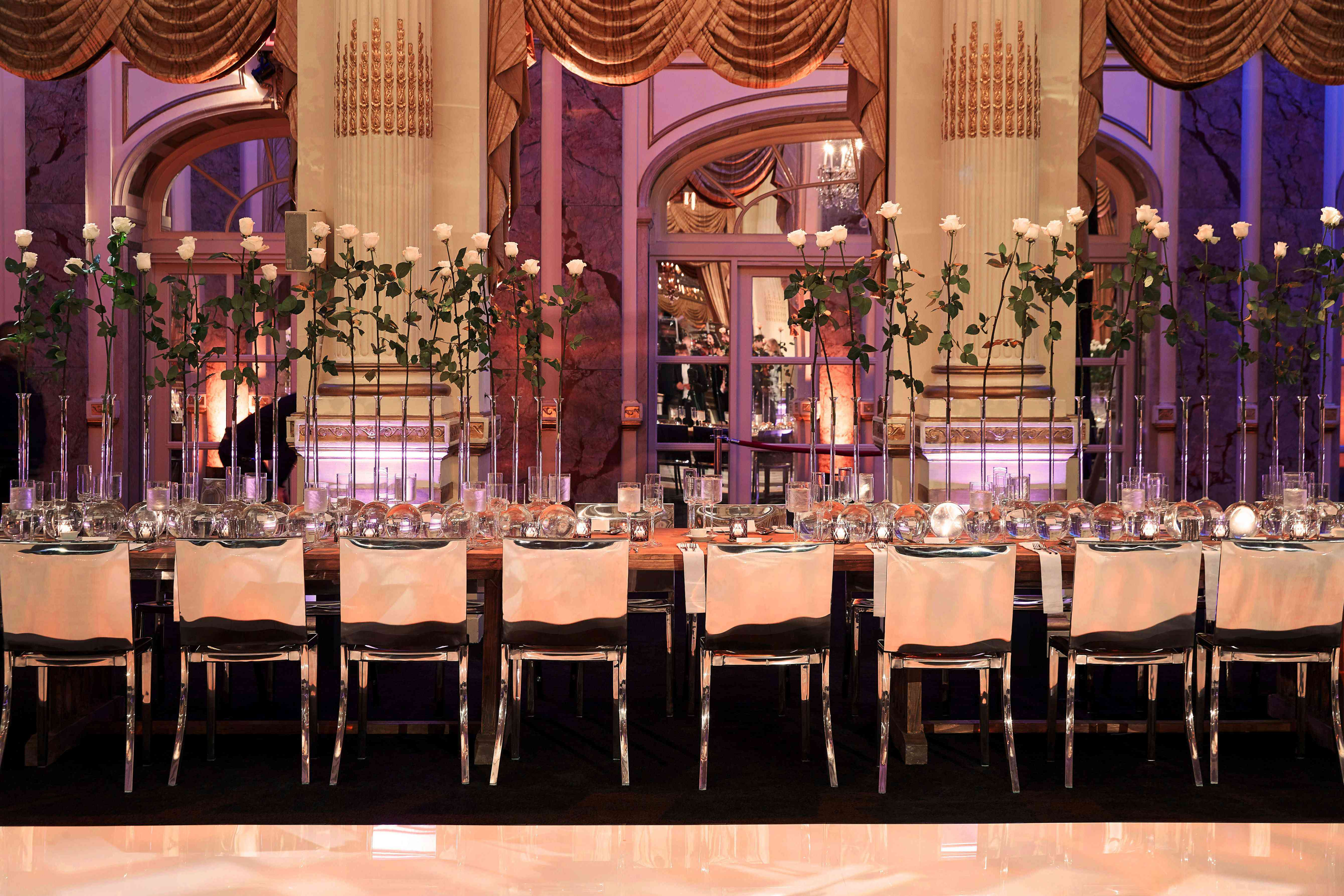 wooden tables silver chairs tall floral arrangements