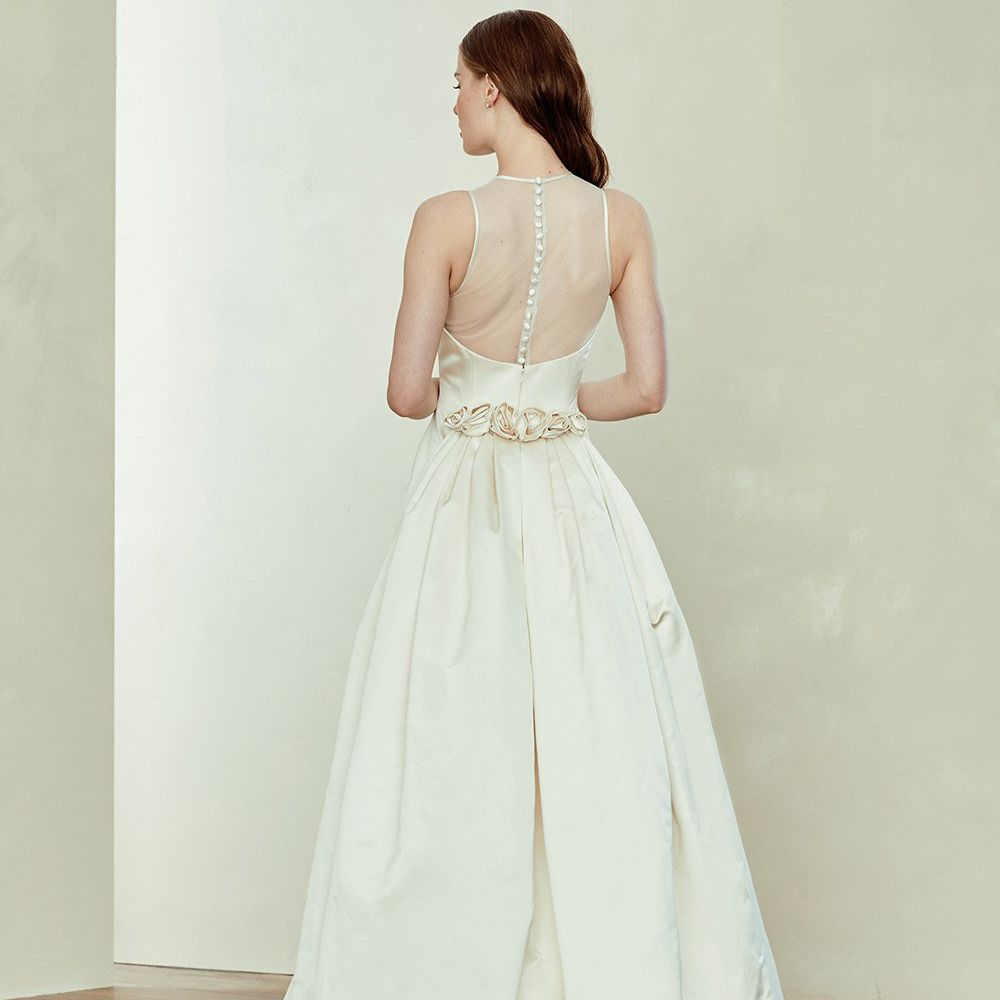 Model in satin bridal gown with rose embellishments