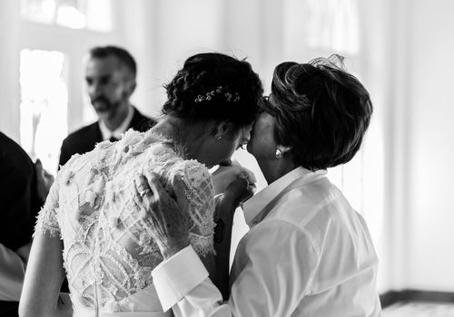 mother comforting daughter at her wedding