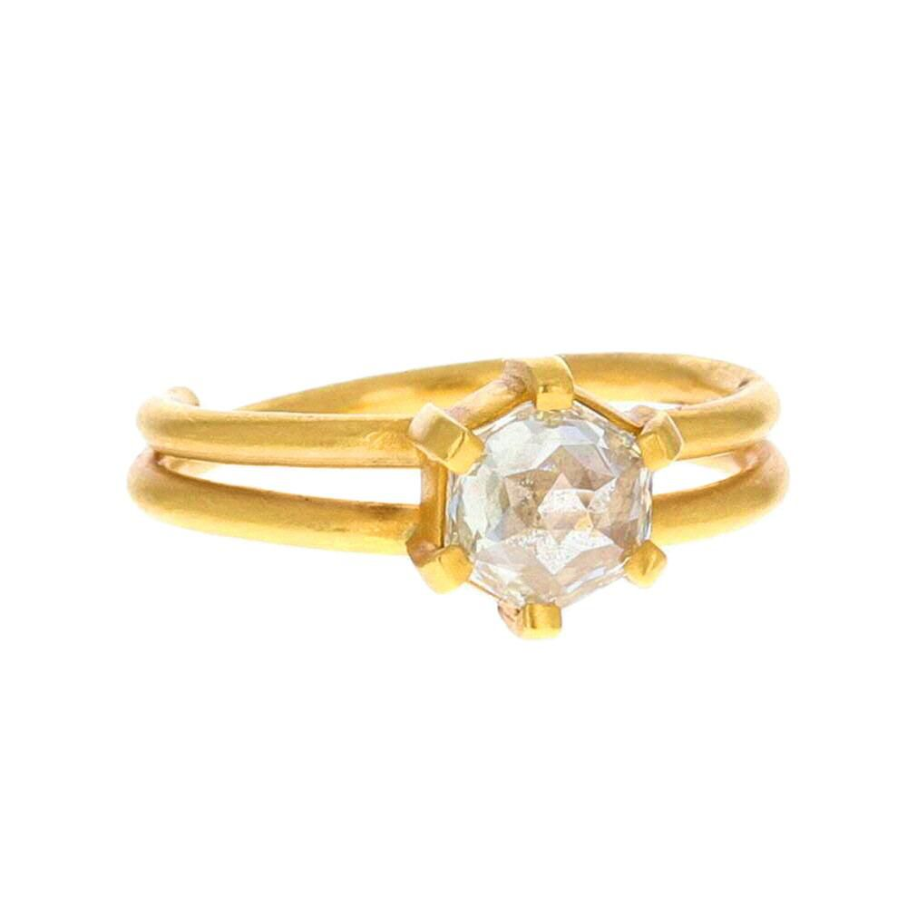 Hexagon-shaped diamond prong set on a double band gold engagement ring