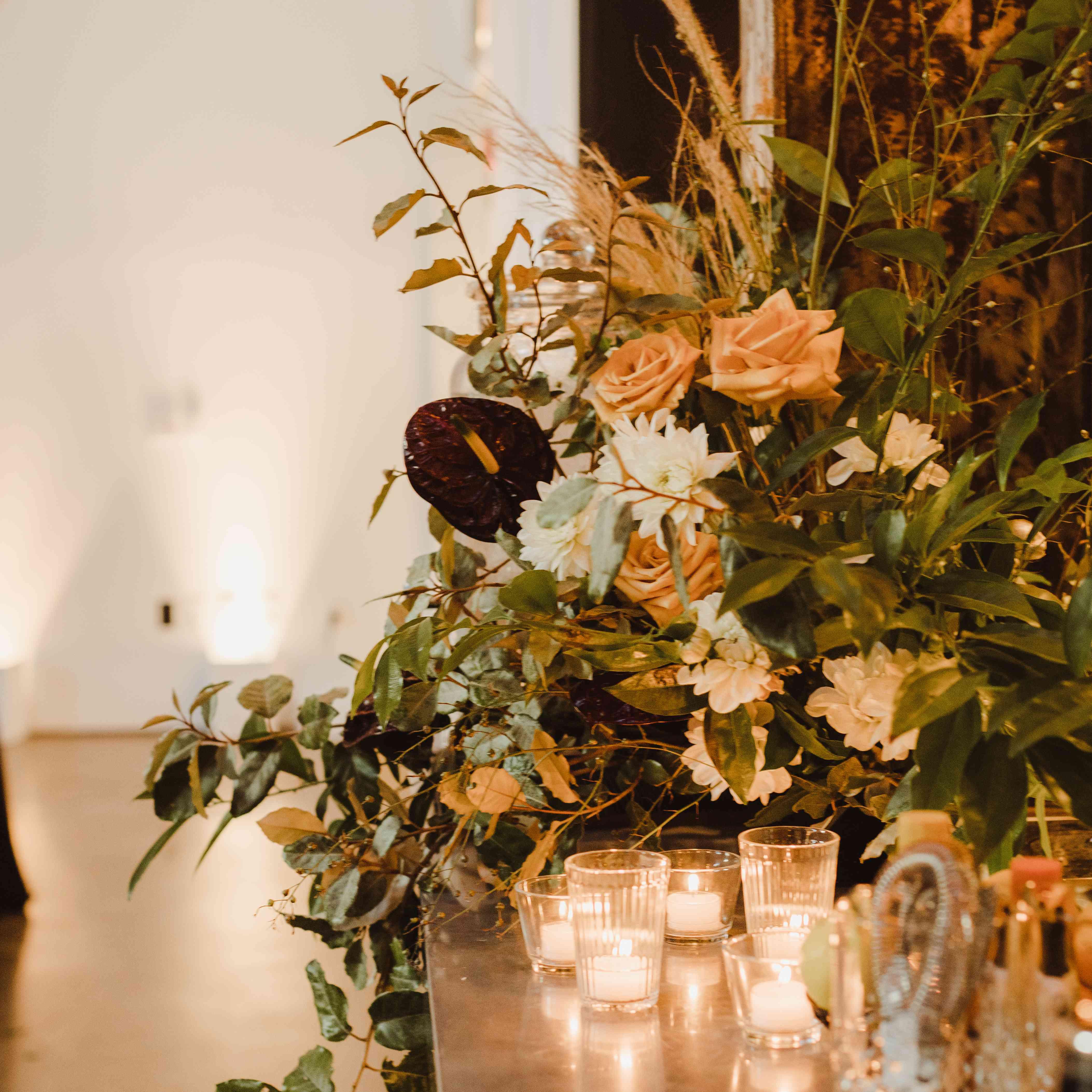 candles and floral arrangement decor
