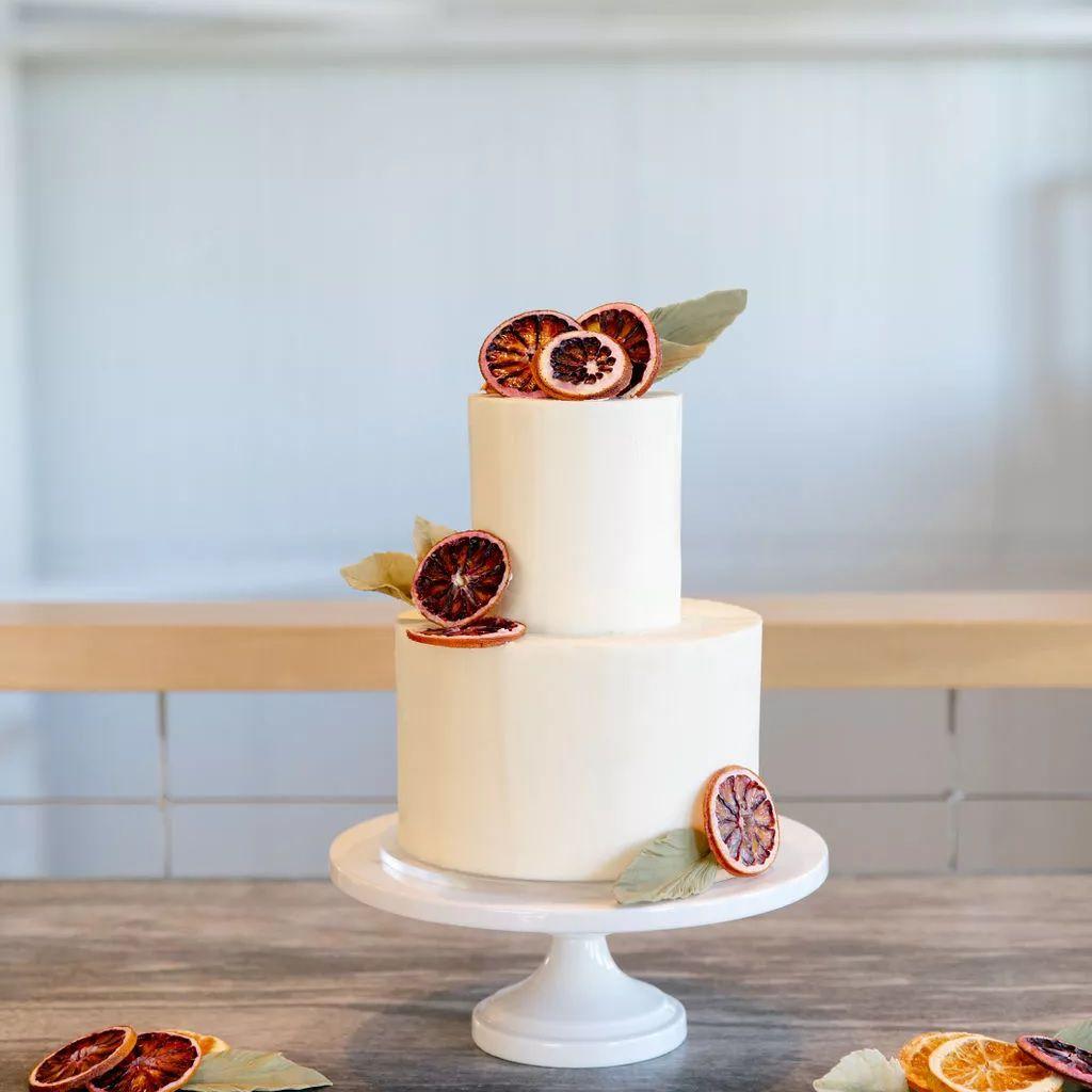 White wedding cake with blood oranges