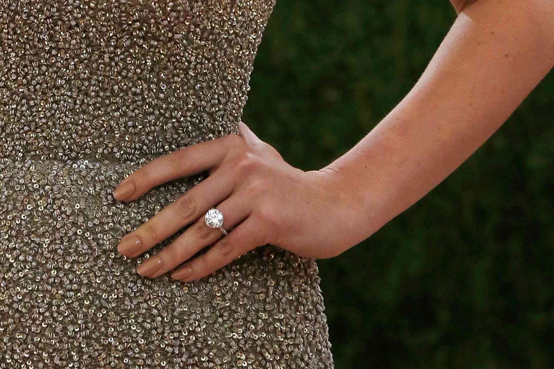 """NEW YORK, NY - MAY 02: Kate Upton, engagement ring detail, attends """"Manus x Machina: Fashion in an Age of Technology"""", the 2016 Costume Institute Gala at the Metropolitan Museum of Art on May 02, 2016 in New York, New York. (Photo by Taylor Hill/FilmMagic)"""