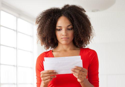 Woman upset reading letter