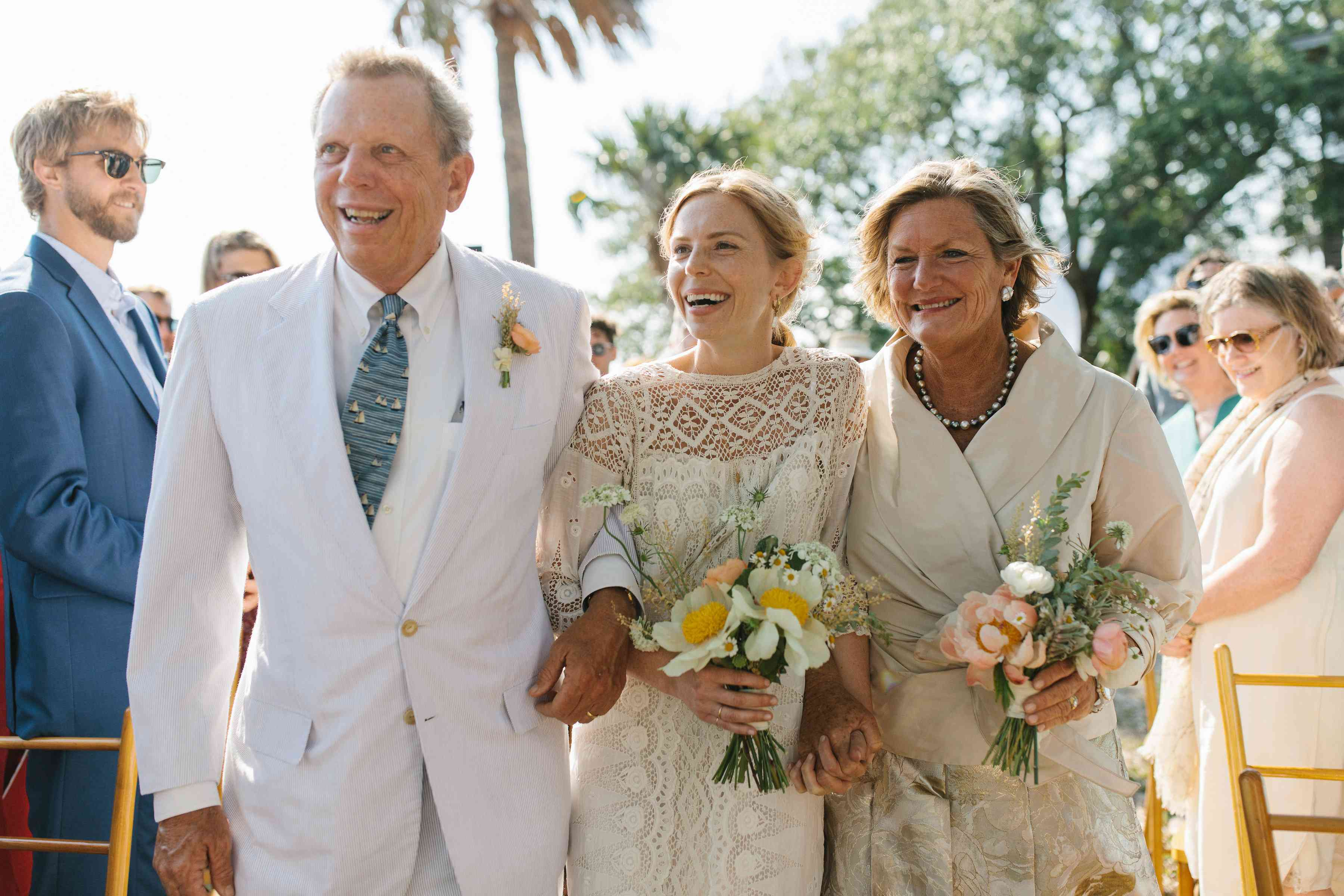 <p>bride walking down the aisle with both parents</p><br><br>