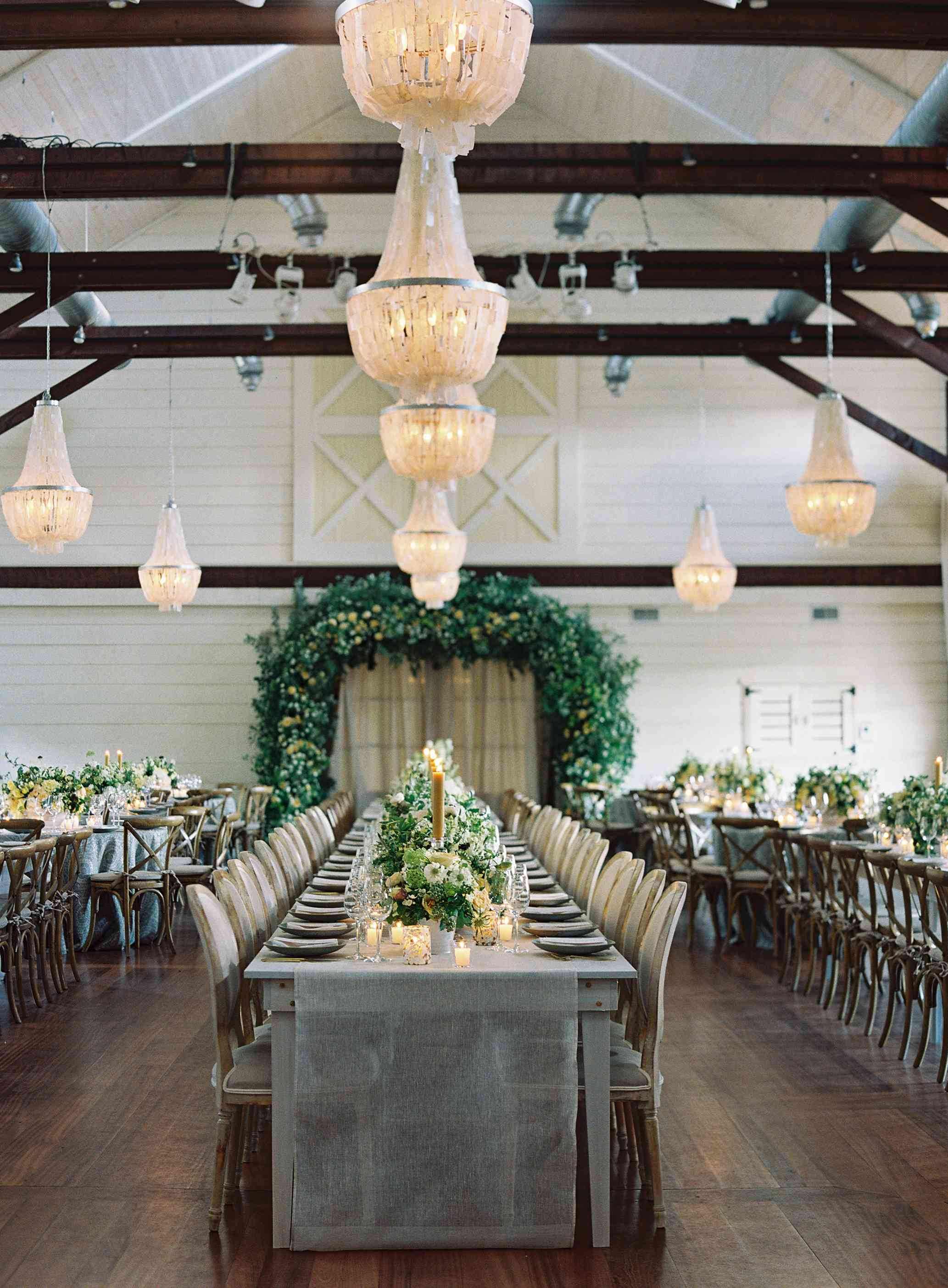 <p>chandeliers and rustic wood accents</p>