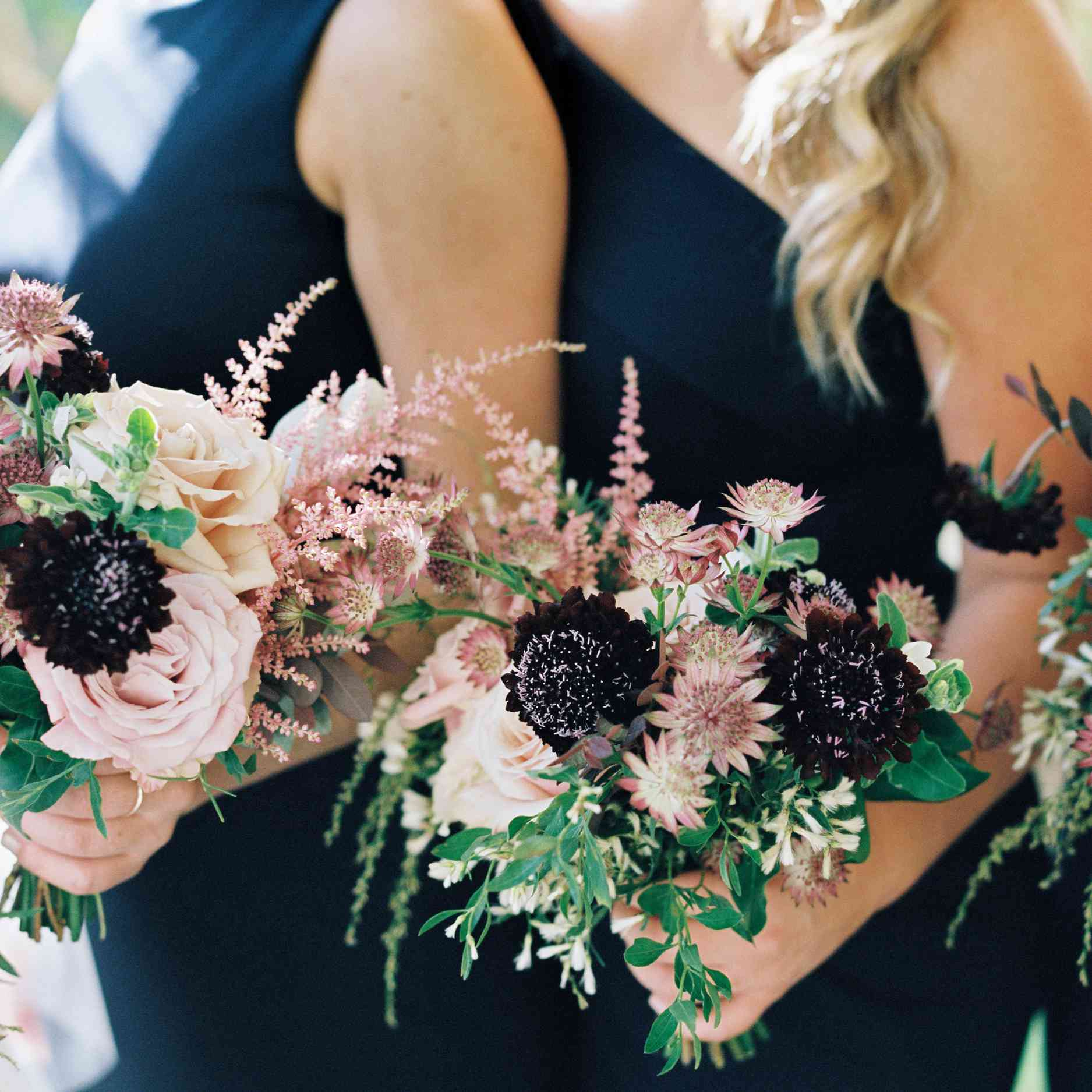 Bridal bouquets of David Austin roses, garden roses, astrantia, astilbe, and scabiosa