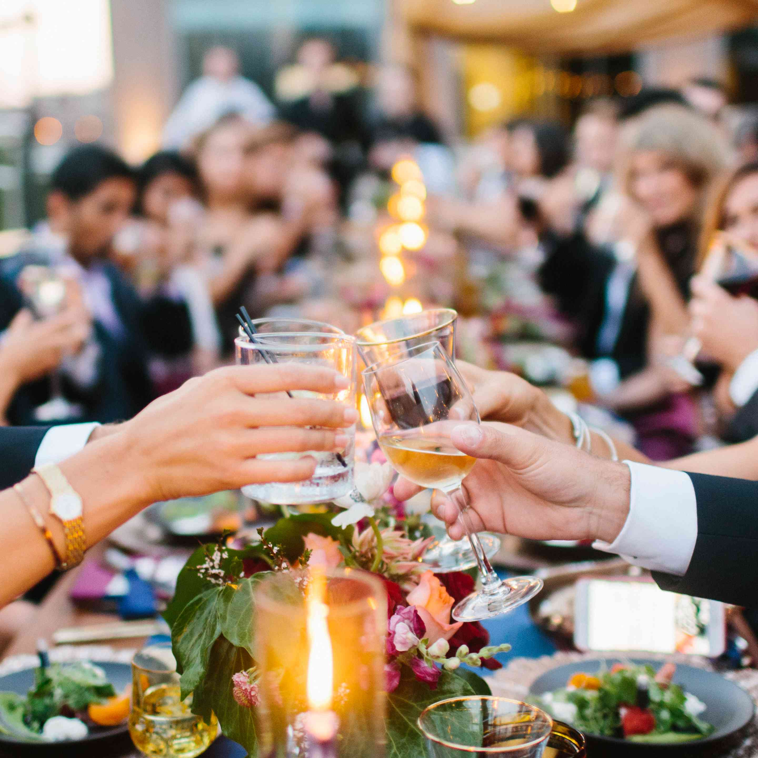 Guests cheers at dinner