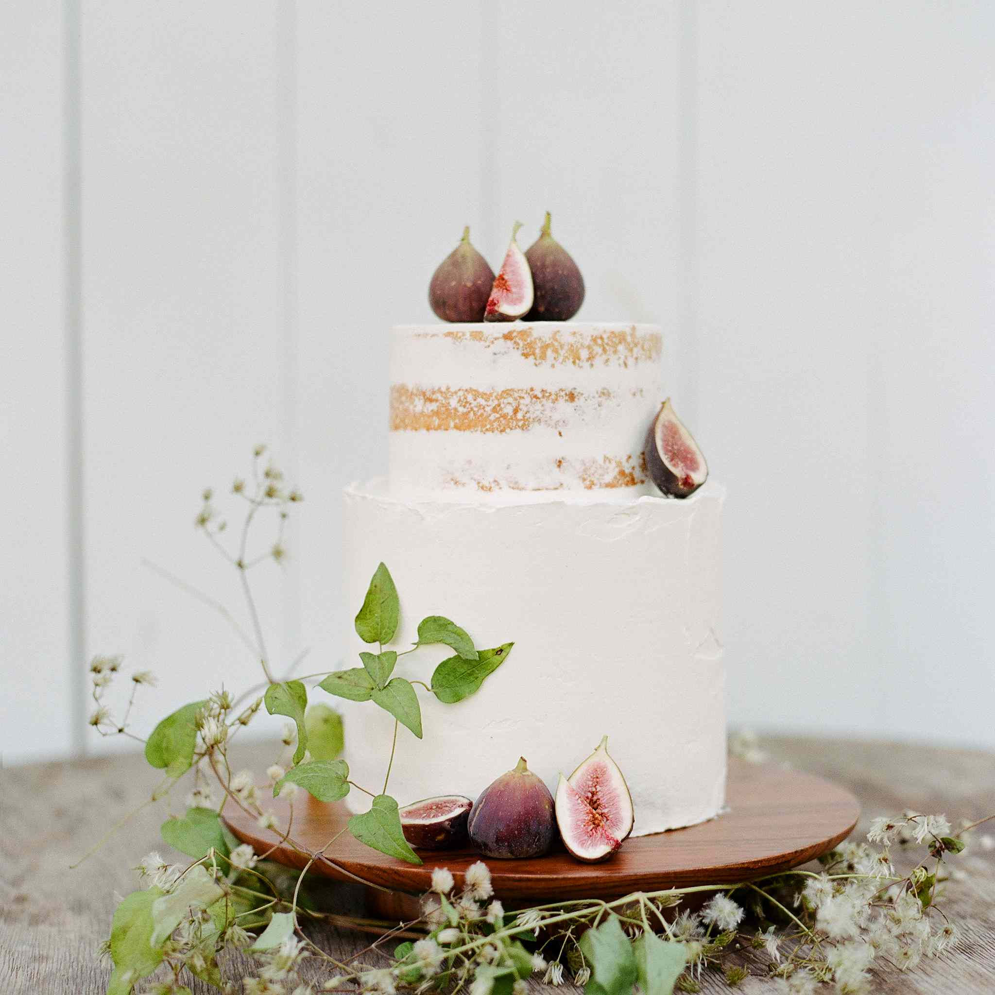 White tiered semi-naked cake with apricot accents