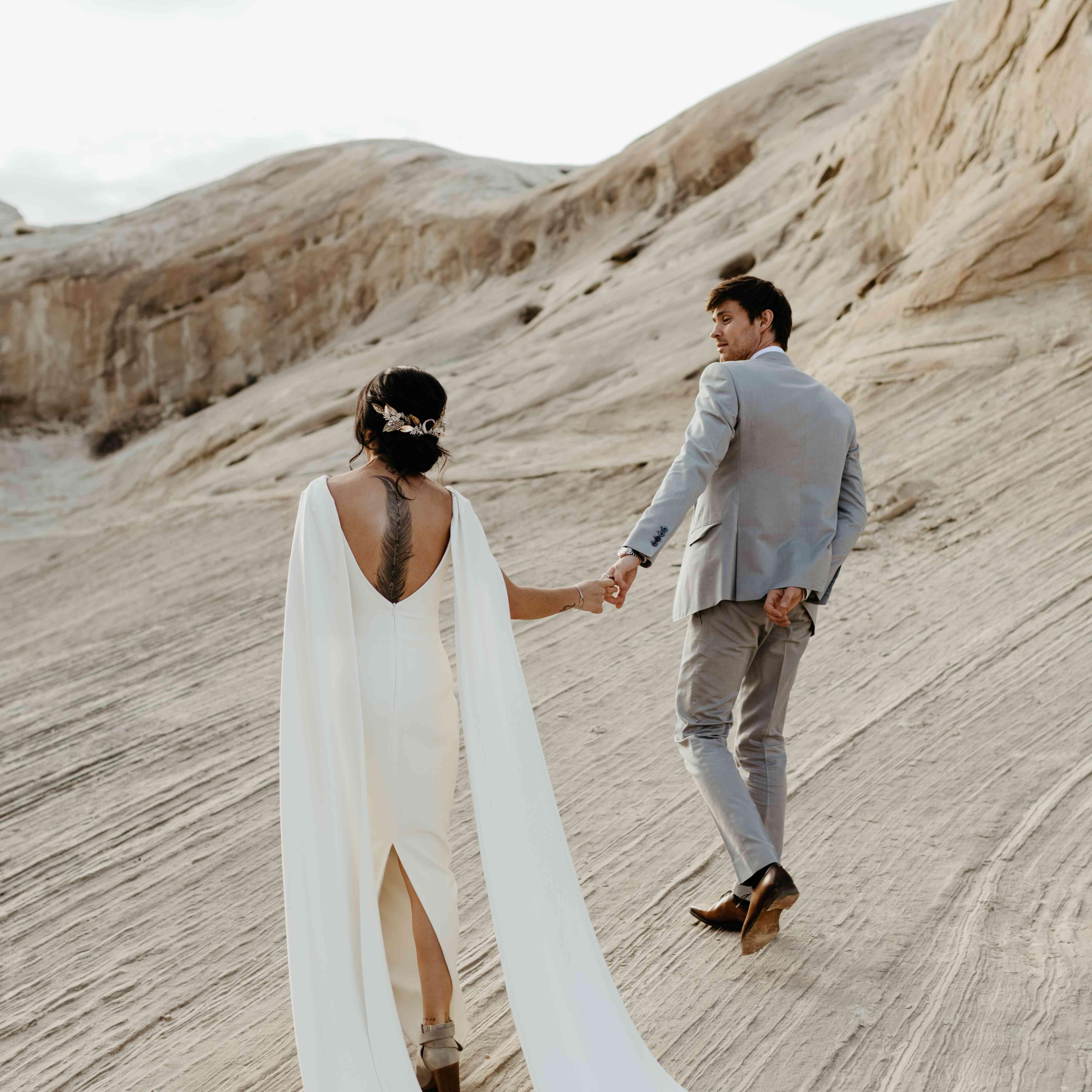 Newlyweds walking through Canyon Point