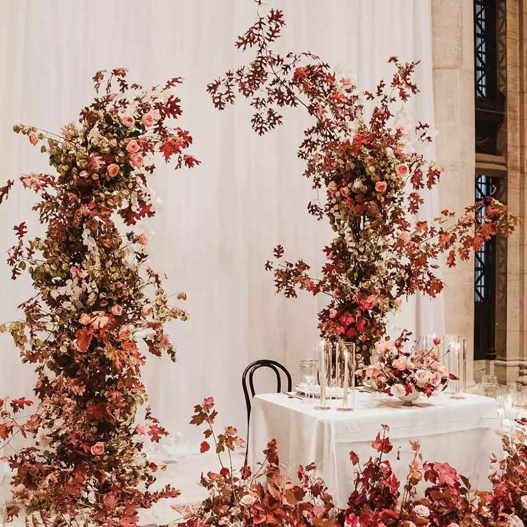 Sweetheart tables surrounded by red florals