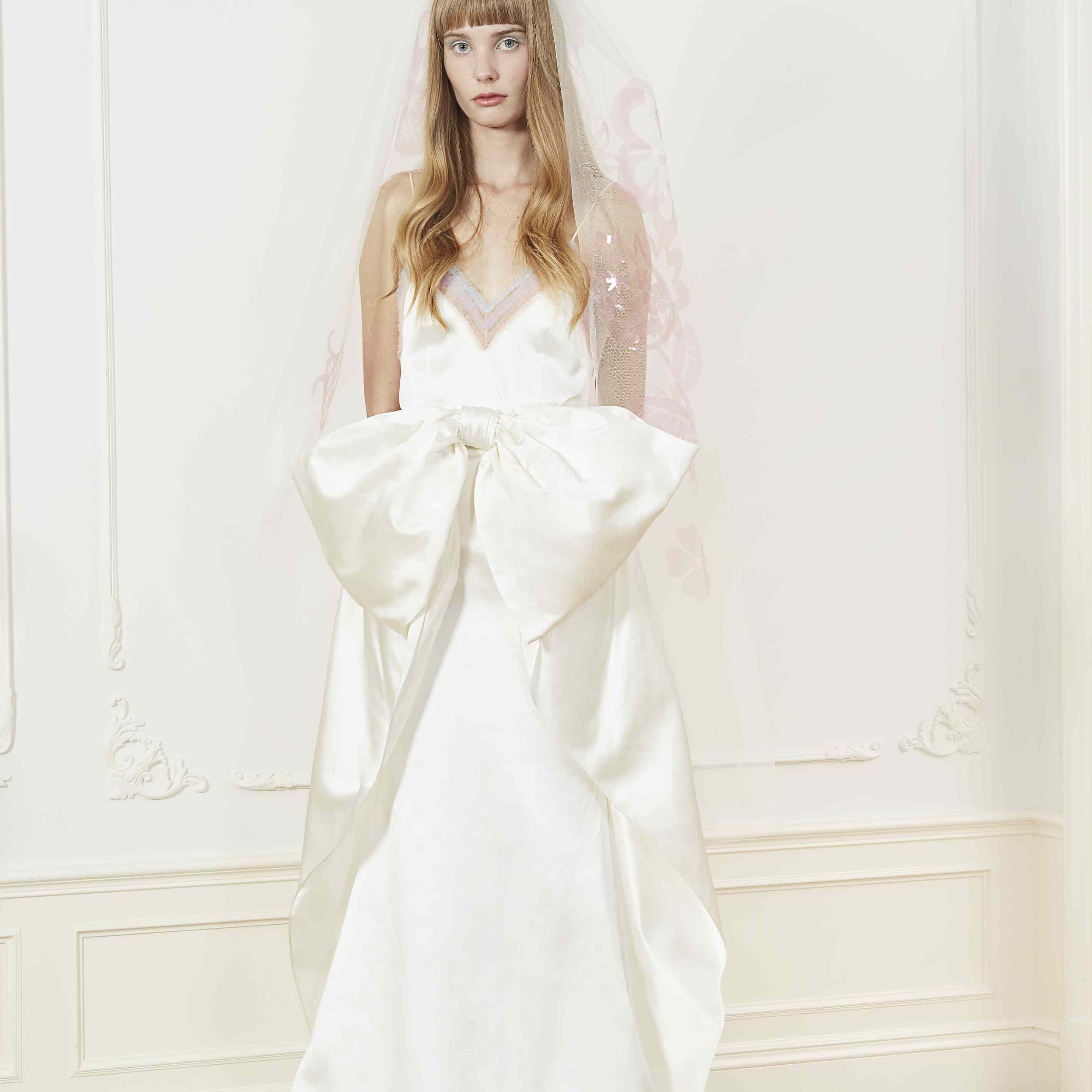 Model in two-piece wedding camisole and bow skirt