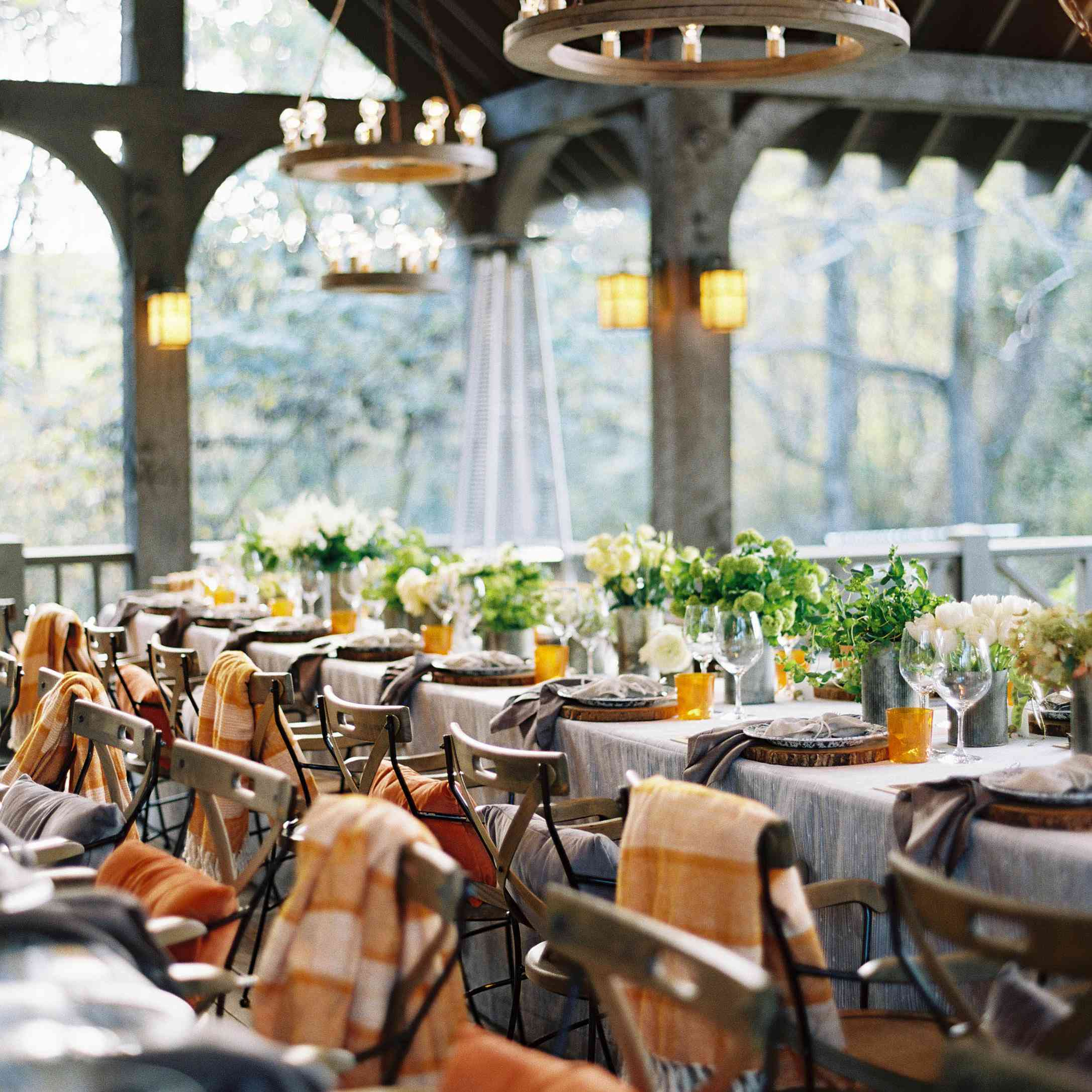 Intimate wedding reception with blankets and warm lighting