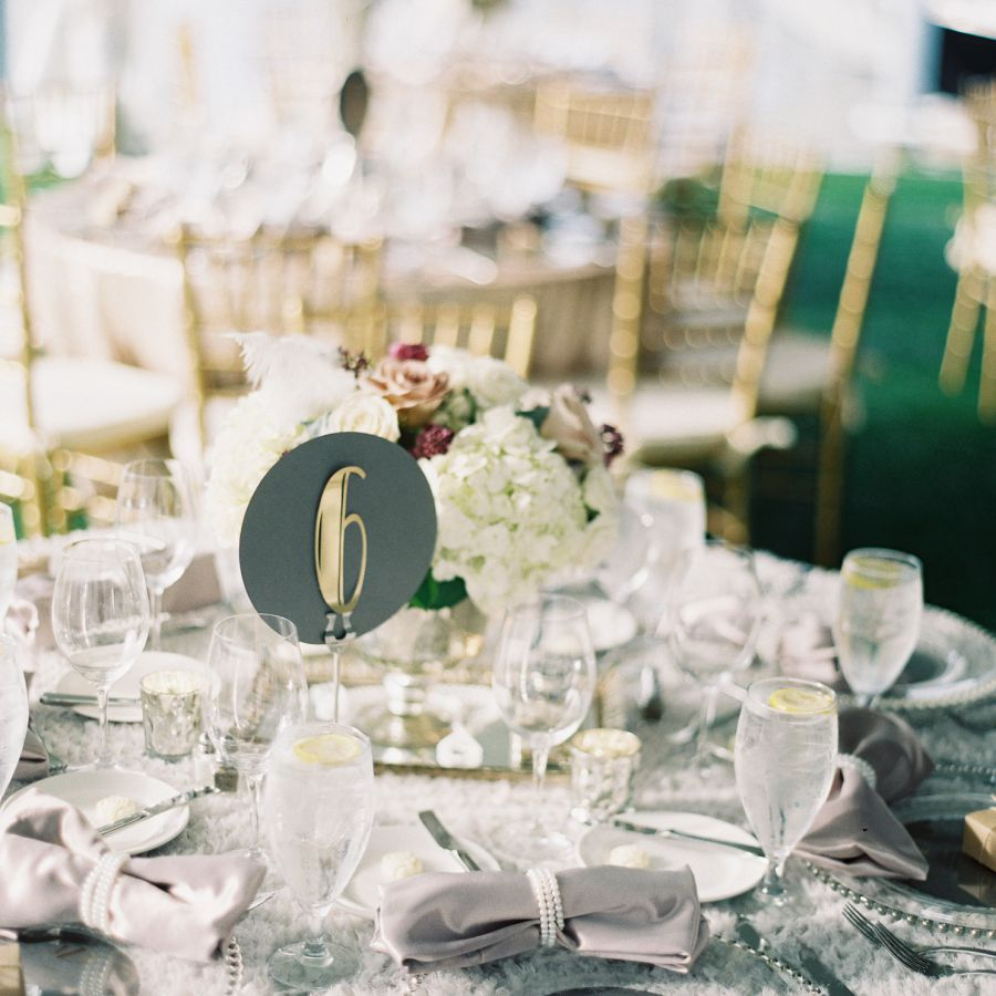 Rounded table numbers at wedding reception