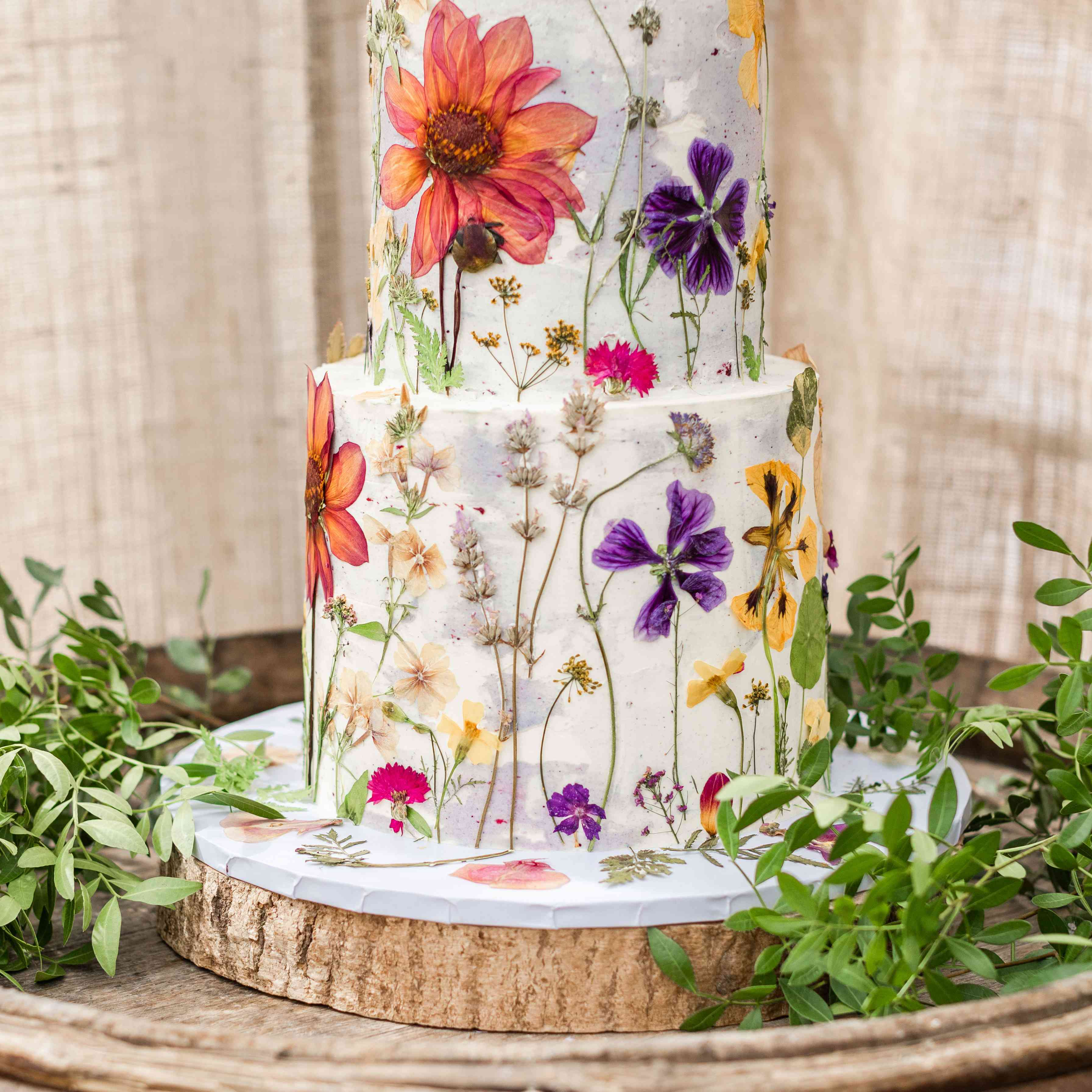 two tiered cake with pressed flowers
