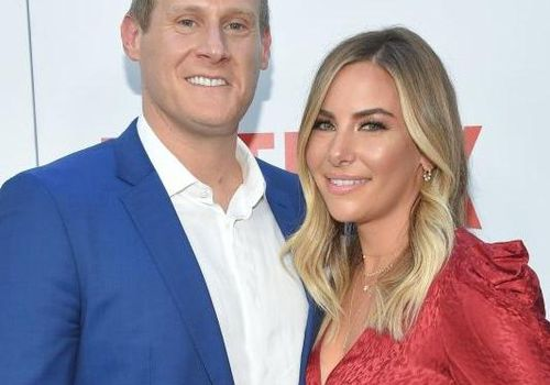 <p>Trevor Engelson and Tracey Kurland pose at the Netflix premiere of