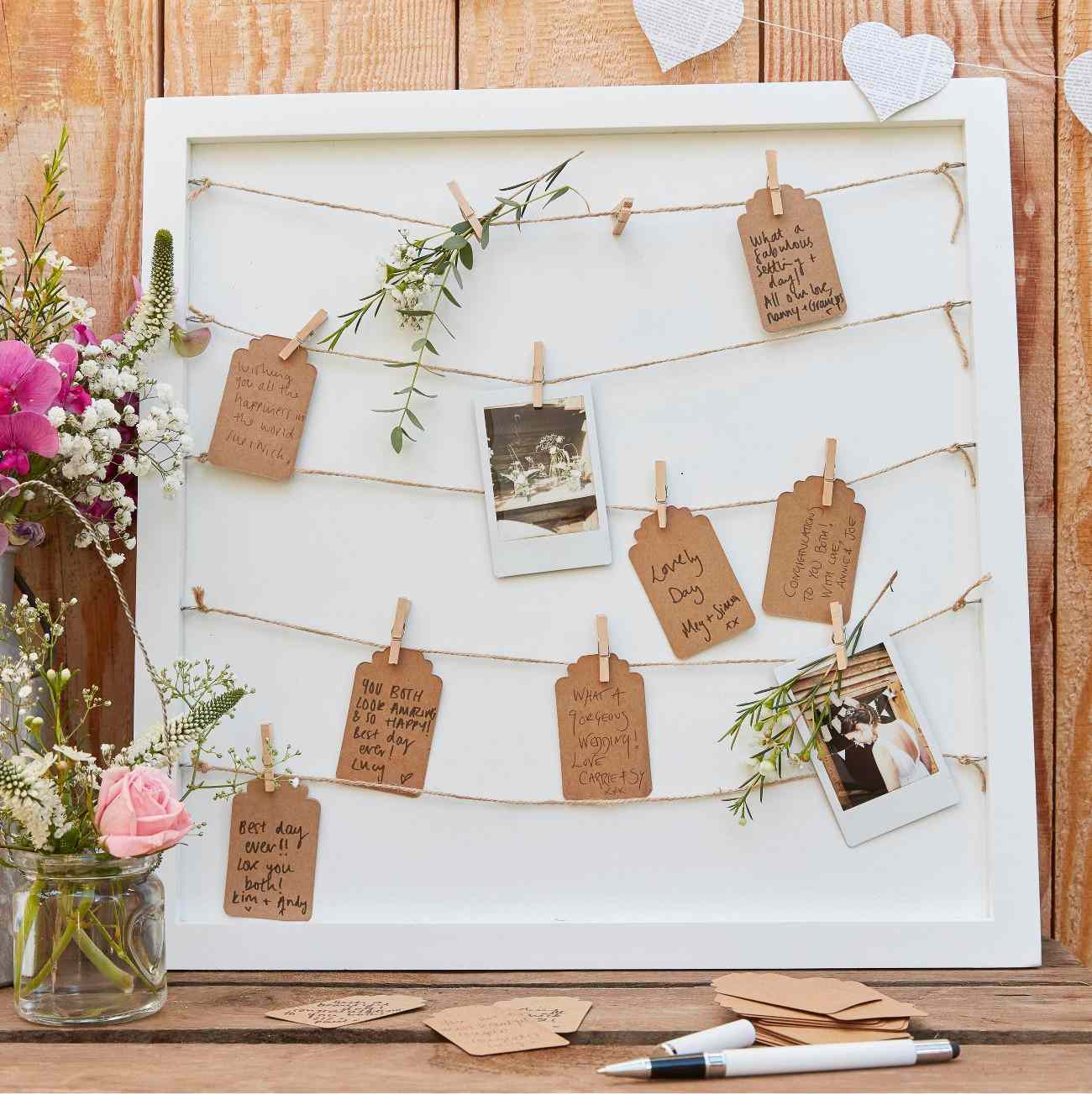 Frame with handwritten notes as wedding guest book