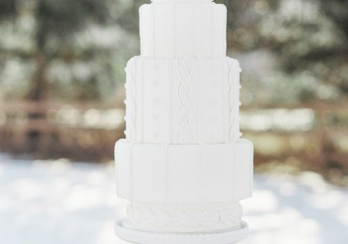 All white winter wedding cake with textured fondant