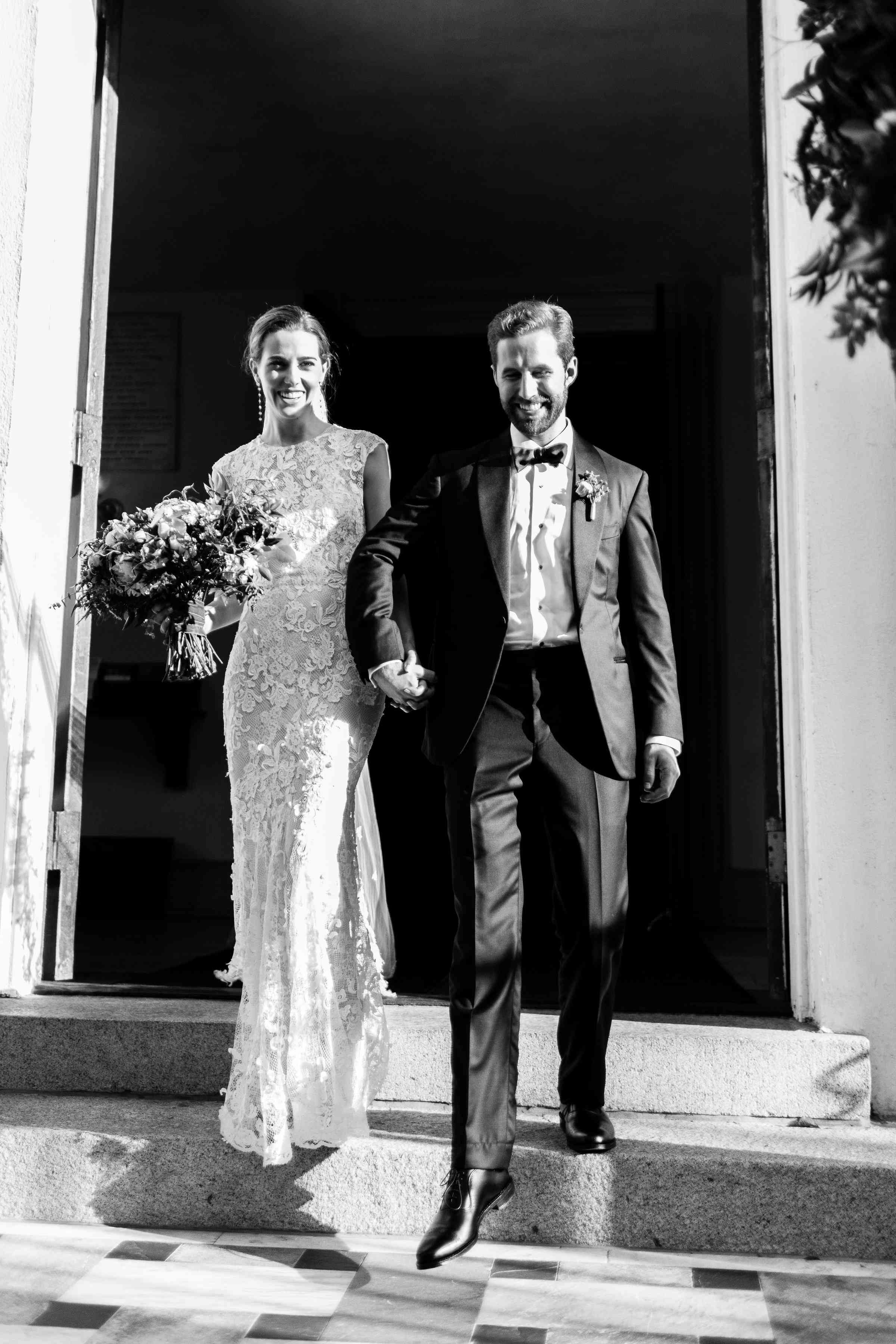 <p>Bride and groom holding hands black and white</p><br><br>