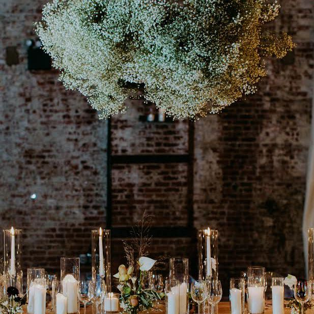 Table setting with baby's breath hanging installation