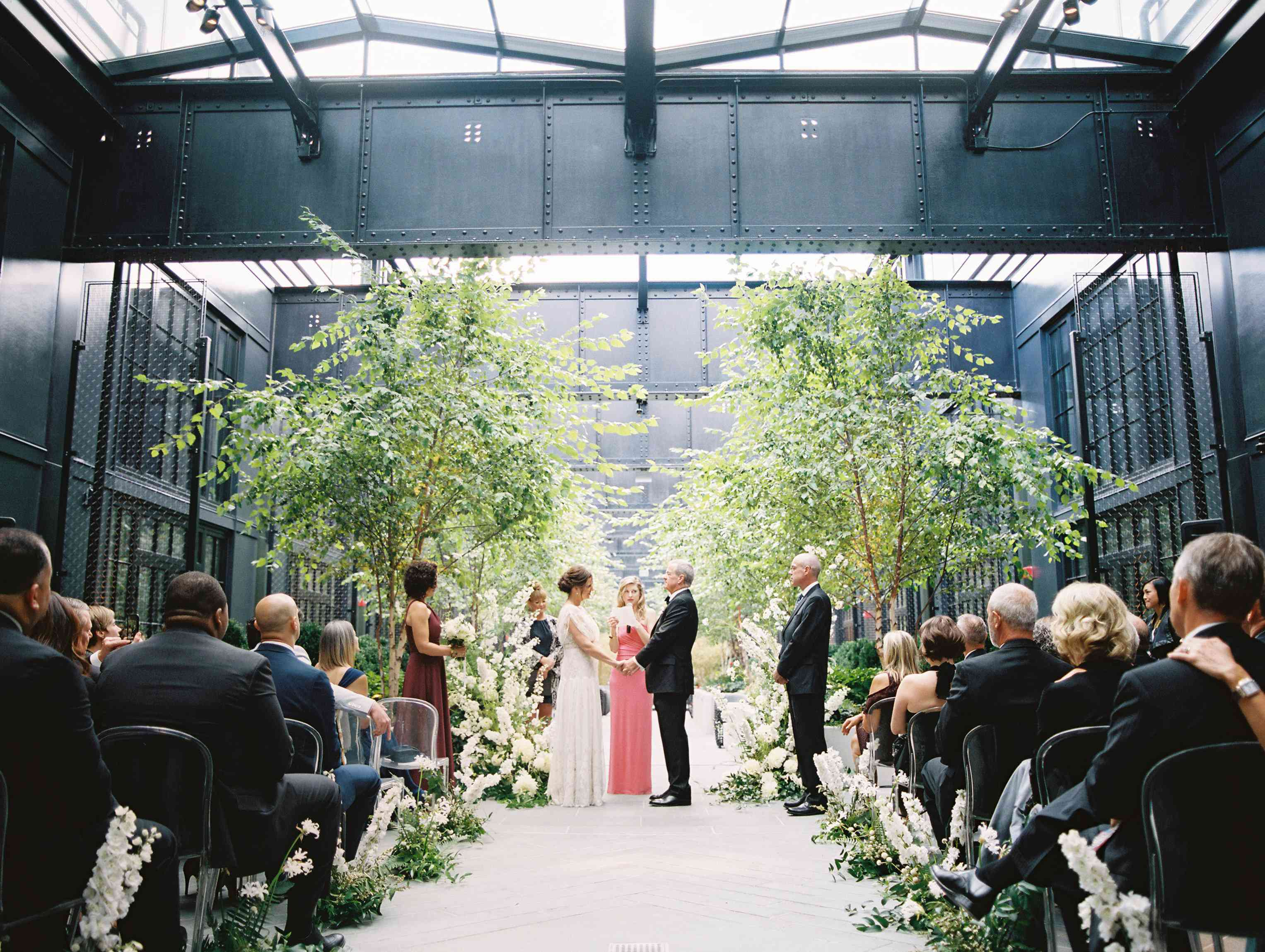 Trees placed indoors for a courtyard wedding