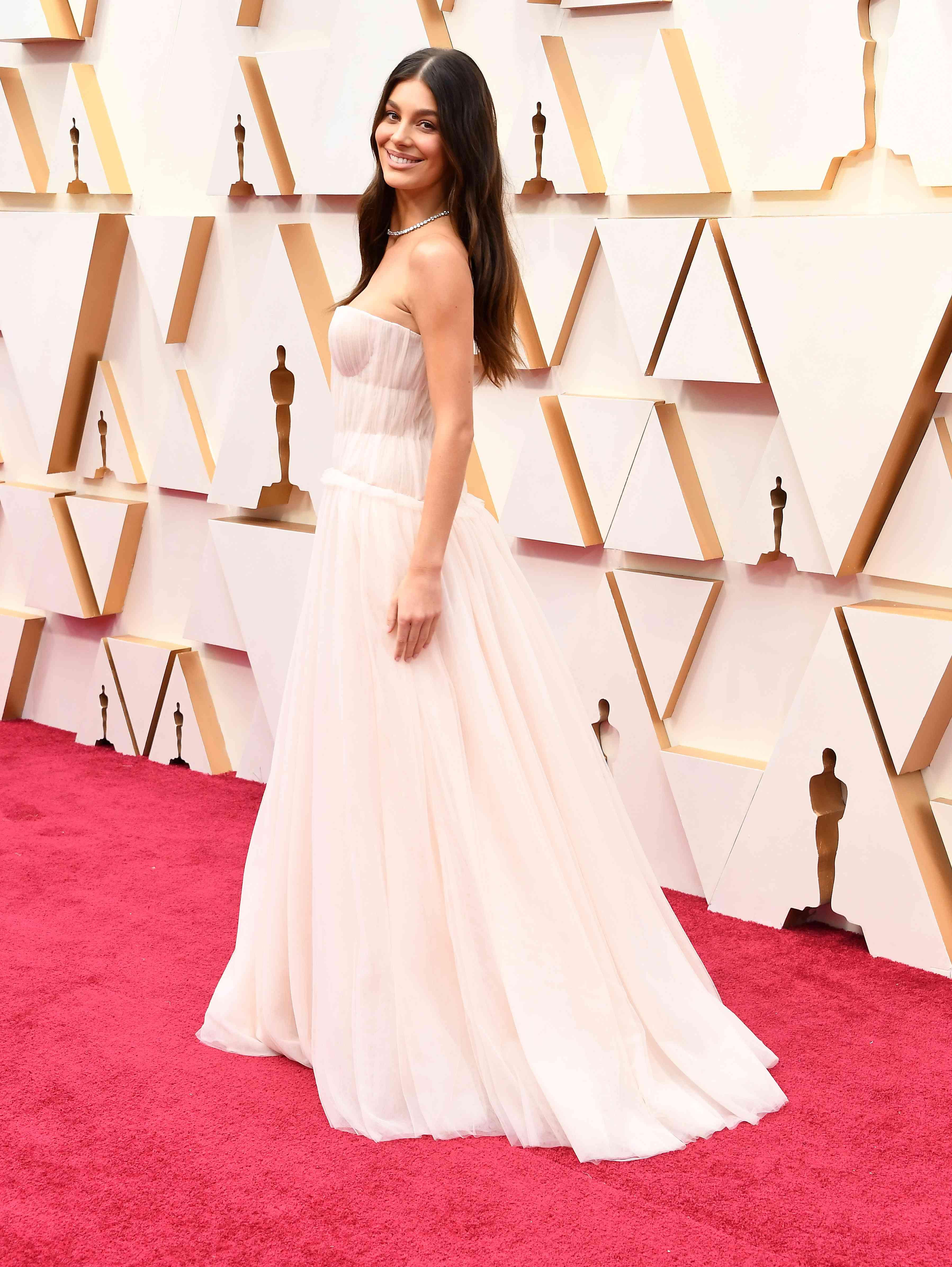 Model Camila Morrone poses on the Oscars red carpet